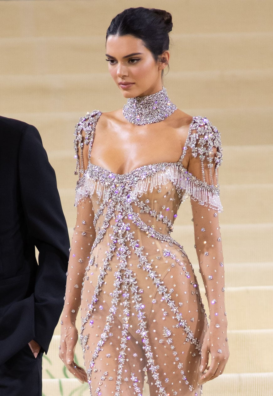 Kendall Jenner lets her dazzling gown take center stage by pairing it with minimal accessories