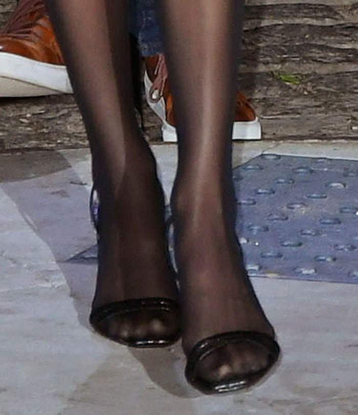 Kendall Jenner pairs her flapper-style mini dress with black tights and slingback sandals