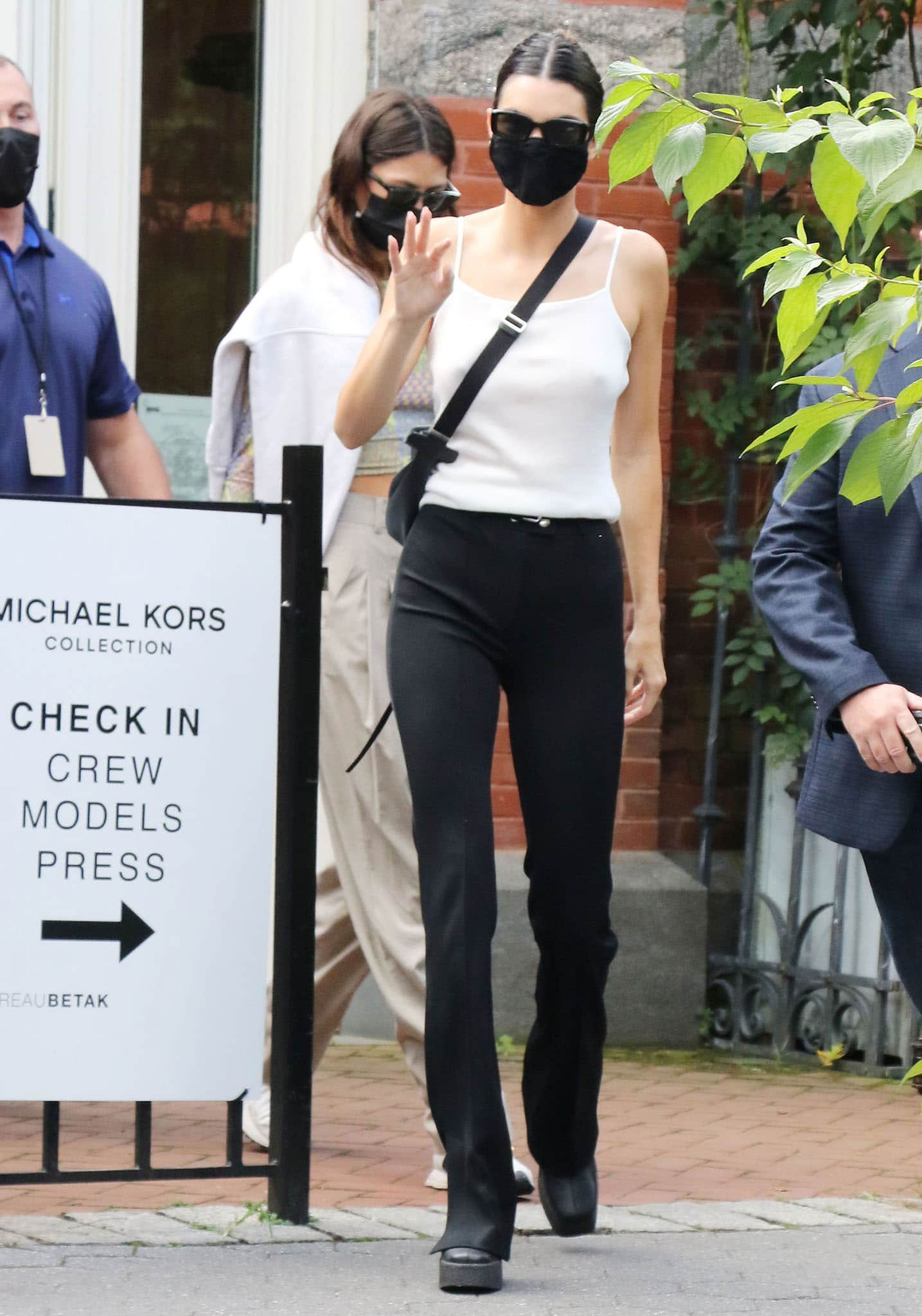 Kendall Jenner goes braless underneath a white tank top with Helmut Lang split hem pants