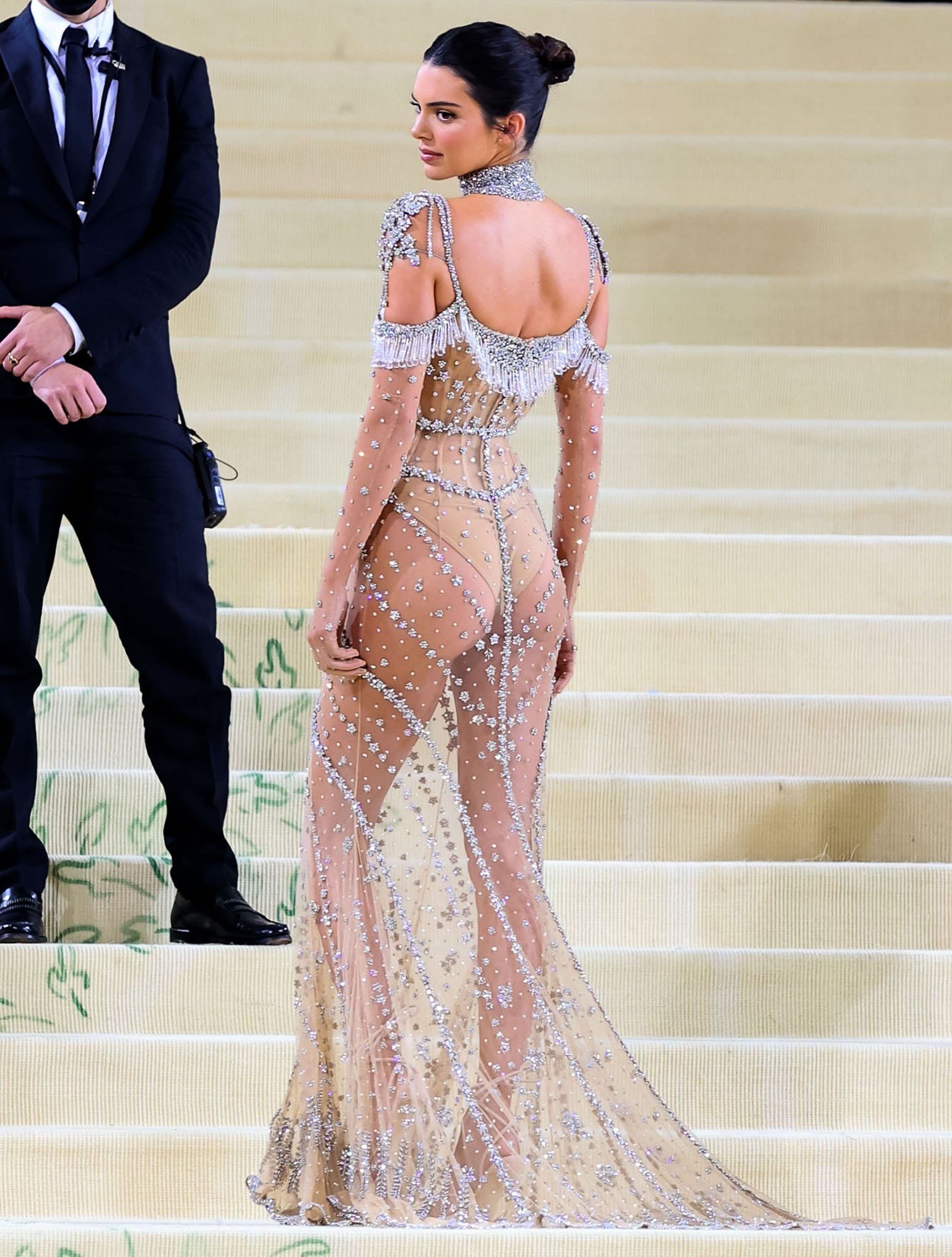 Kendall Jenner showcases her buttcheeks and long legs in Givenchy sheer nude mesh dress