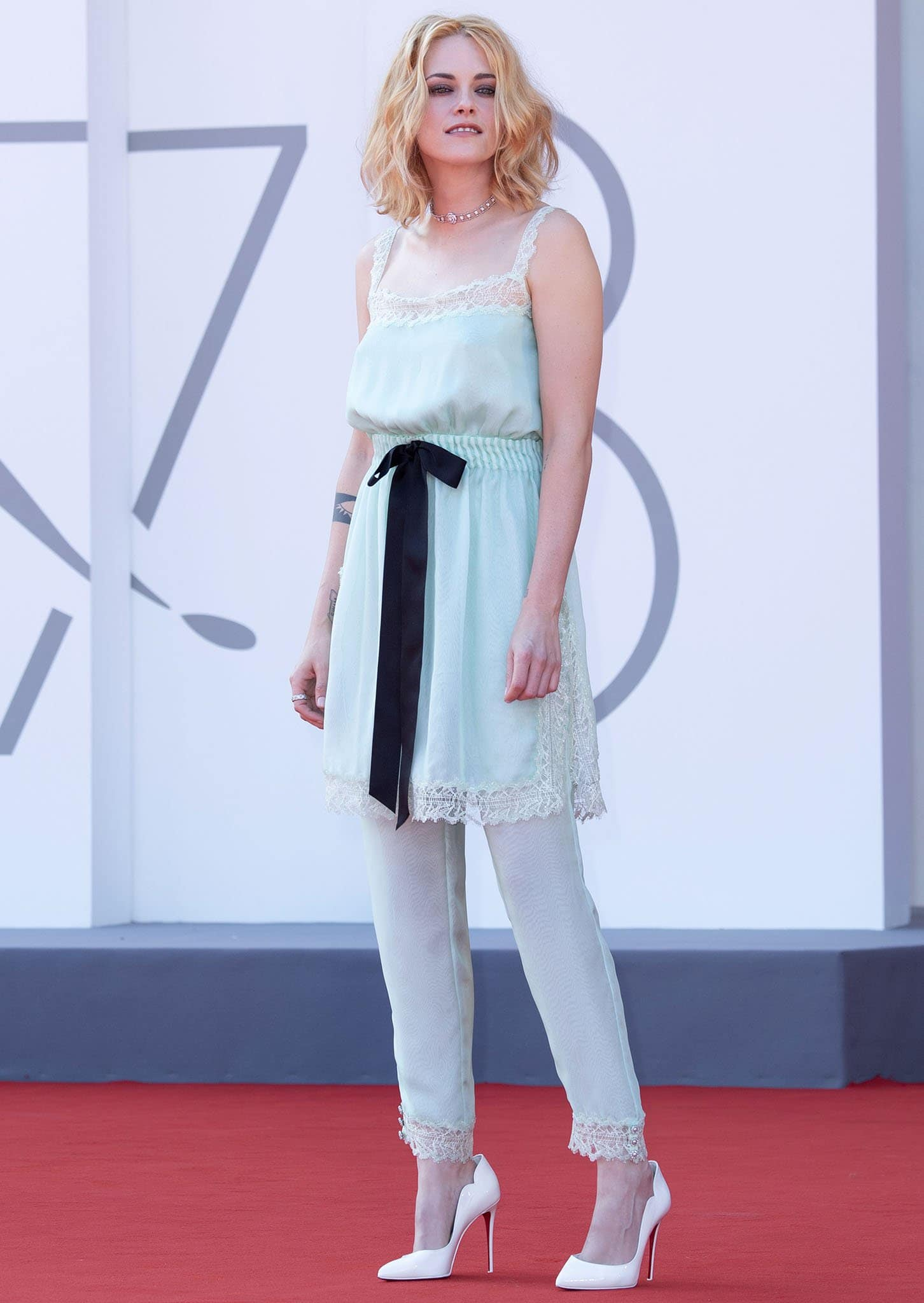 Kristen Stewart looks pretty in her matching lingerie-style mint green Chanel tunic and pants