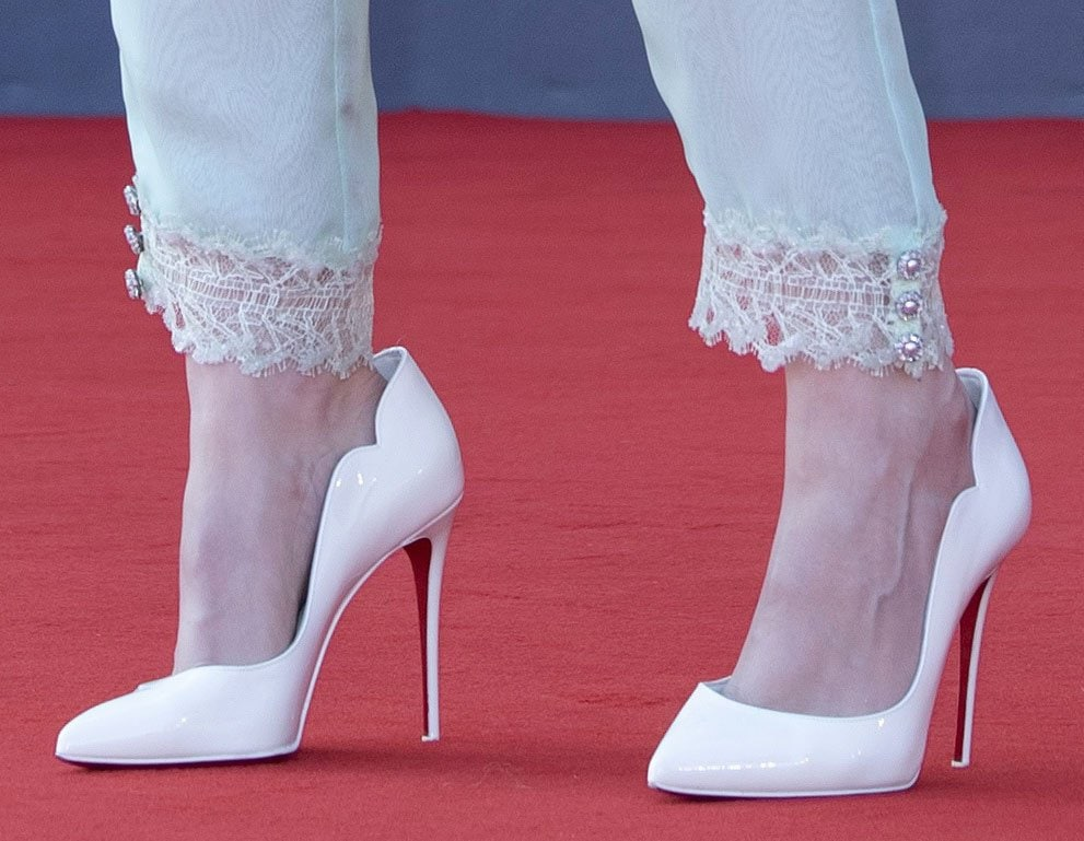 Kristen Stewart teams her Chanel lingerie-style outfit with white Christian Louboutin Hot Chick pumps