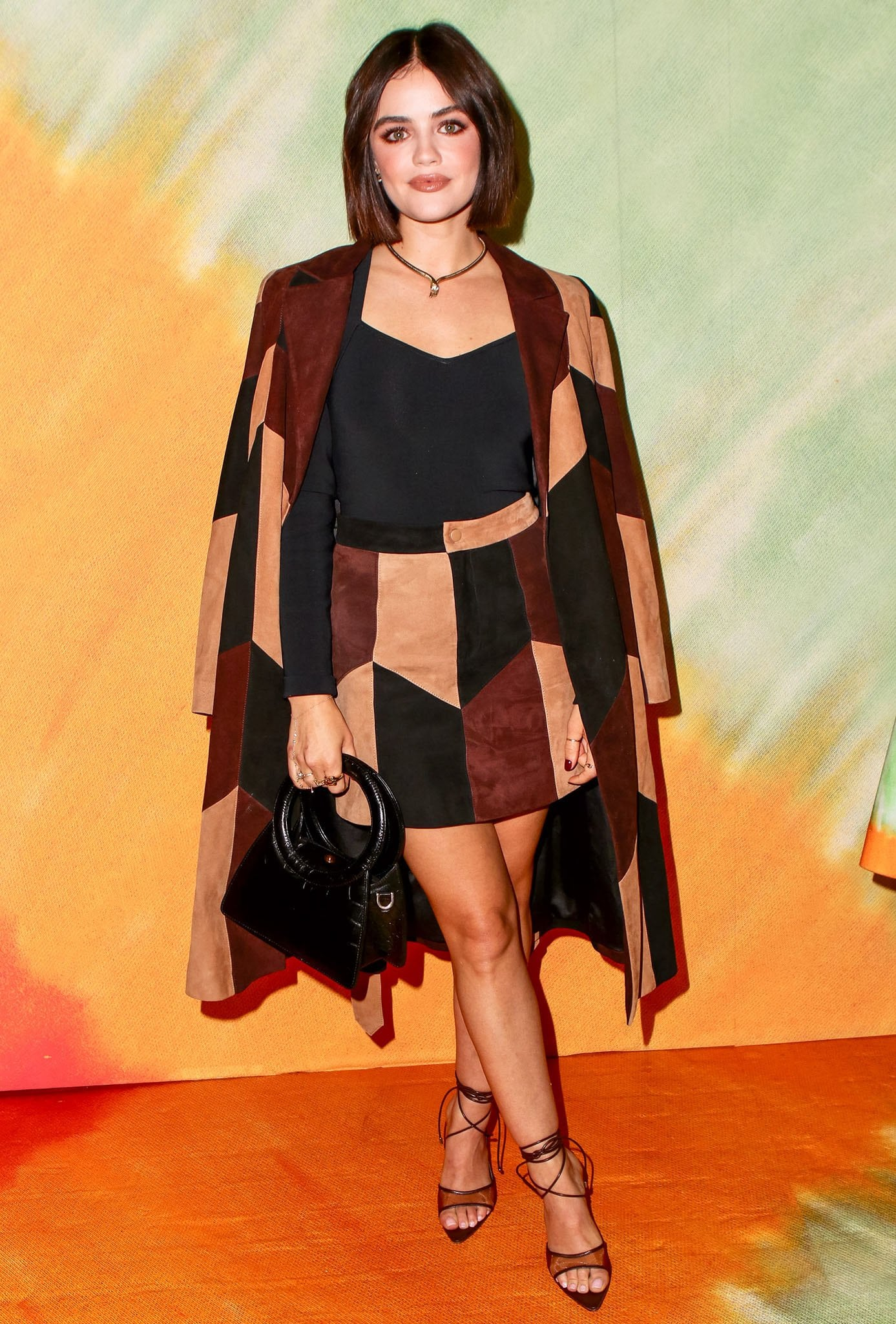 Lucy Hale flaunts her toned legs in Alice + Olivia brown suede geometric mini skirt and matching coat