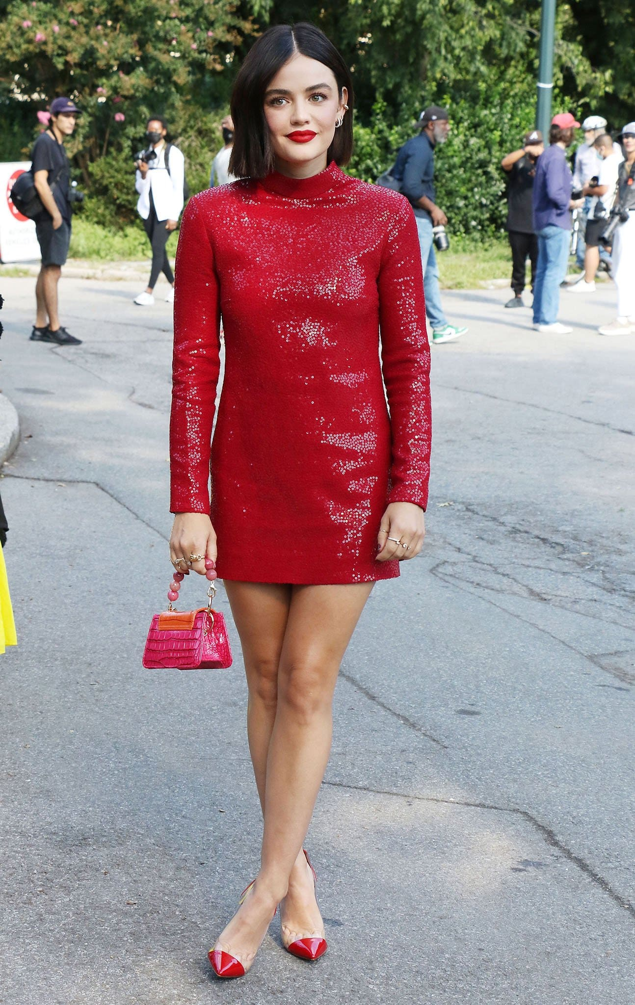 Lucy Hale looks sensational in a red sequined mini dress for Michael Kors Spring/ Summer 2022 runway presentation during NYFW on September 10, 2021