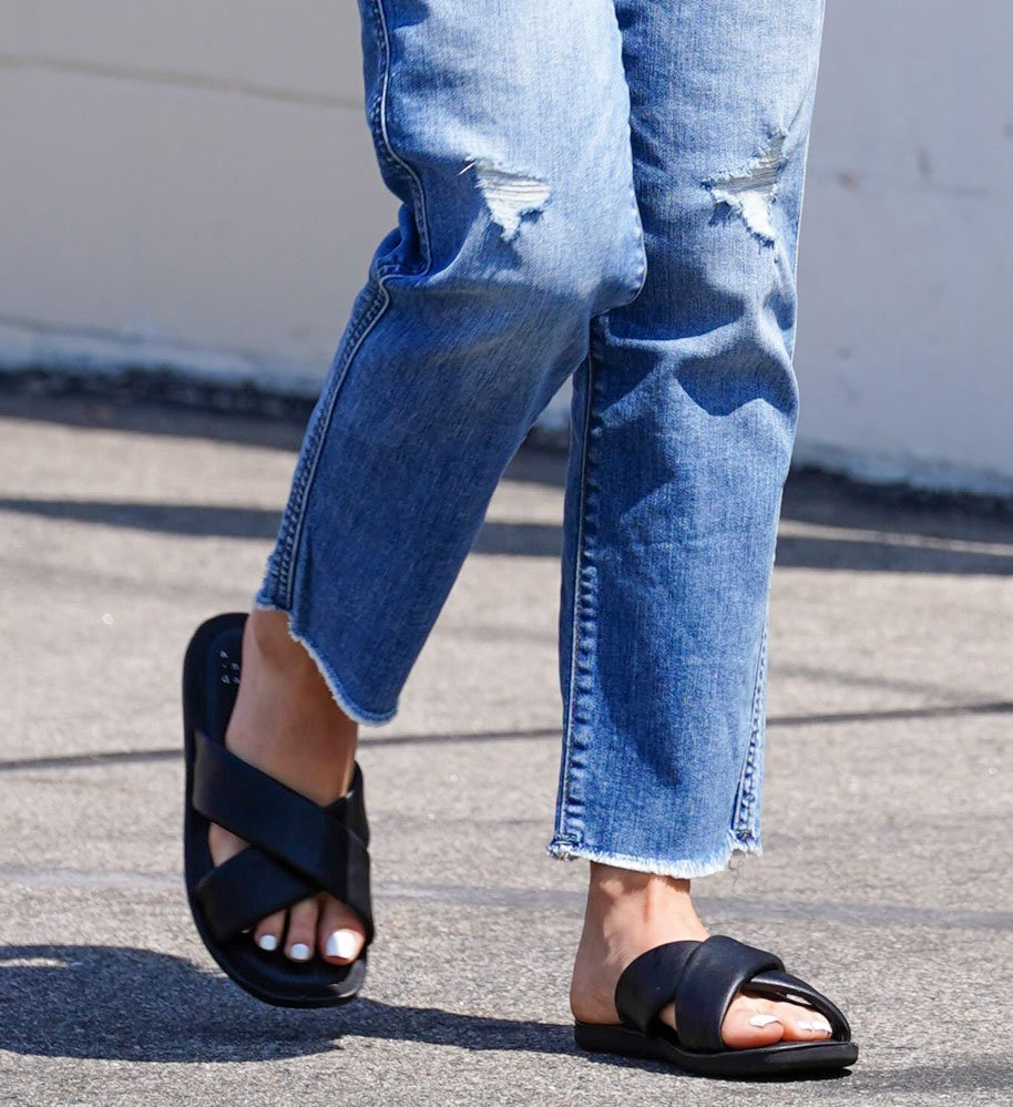 Lucy Hale completes her comfy casual outfit by showing off her feet in padded crossover leather slides