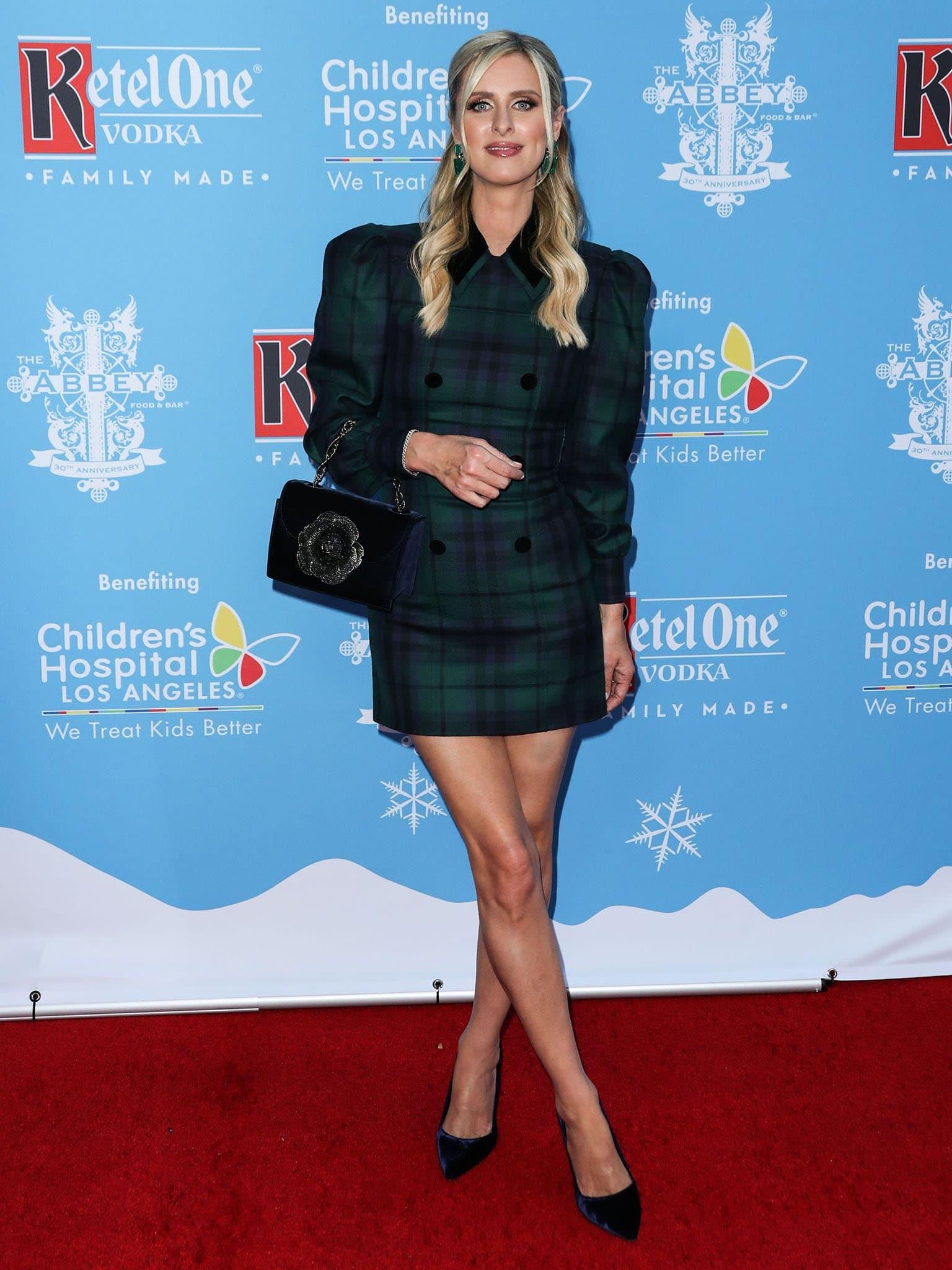 Nicky Hilton wears a simple tartan check mini dress from Alessandra Rich