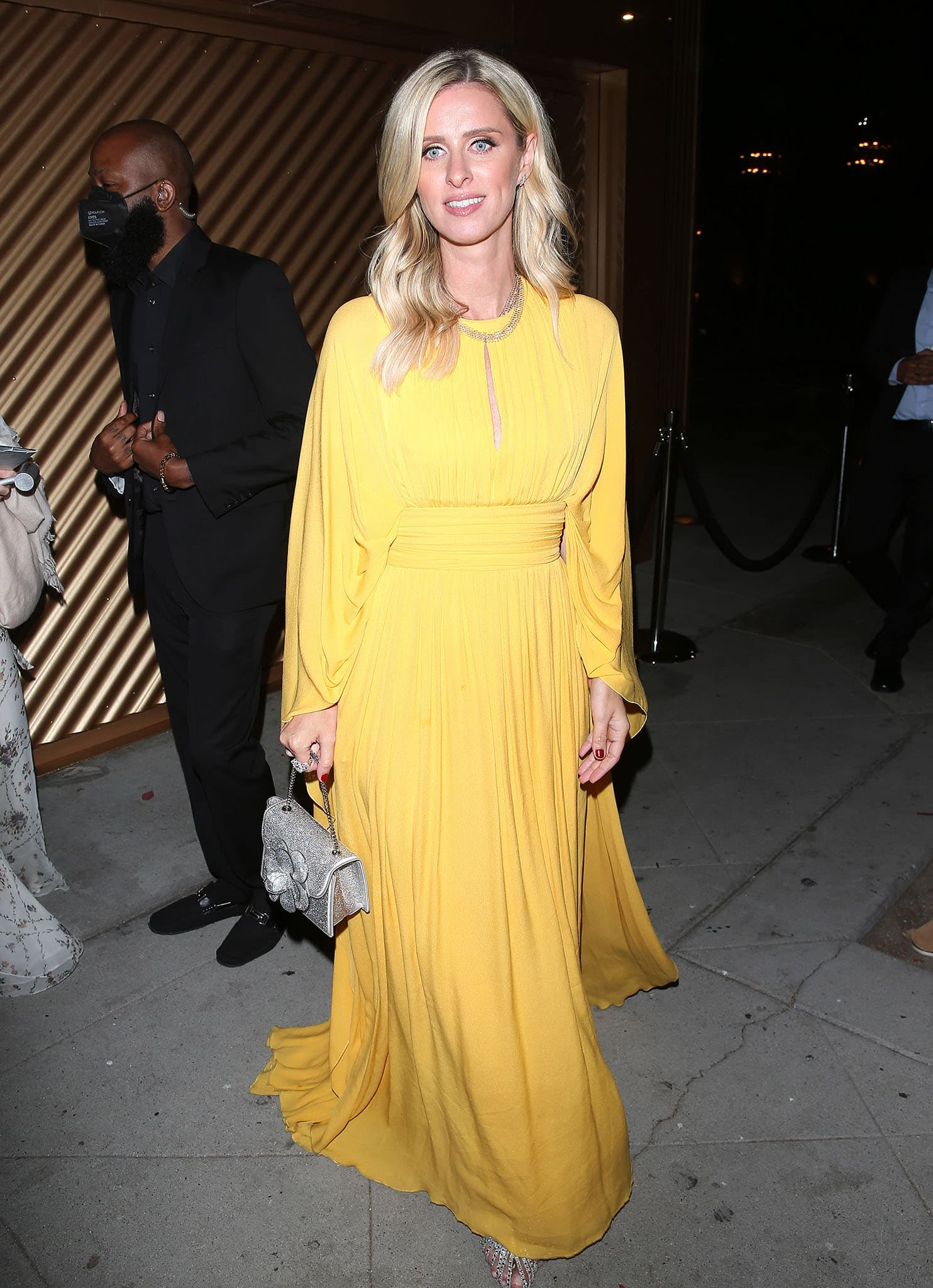 Nicky Hilton dazzles in a yellow Elie Saab Resort 2020 floor-sweeping gown with dramatic long sleeves
