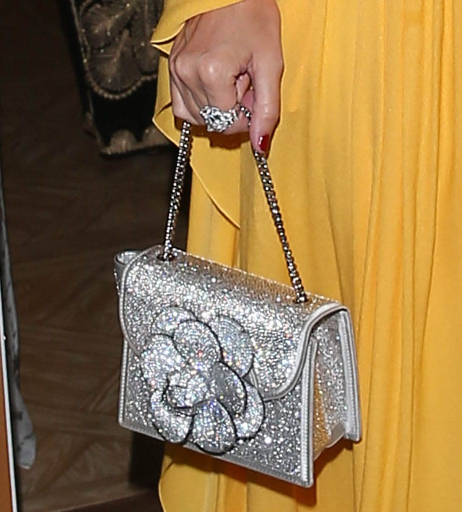 Nicky Hilton adds more sparkle to her look with Oscar de la Renta Swarovski-embellished mini bag
