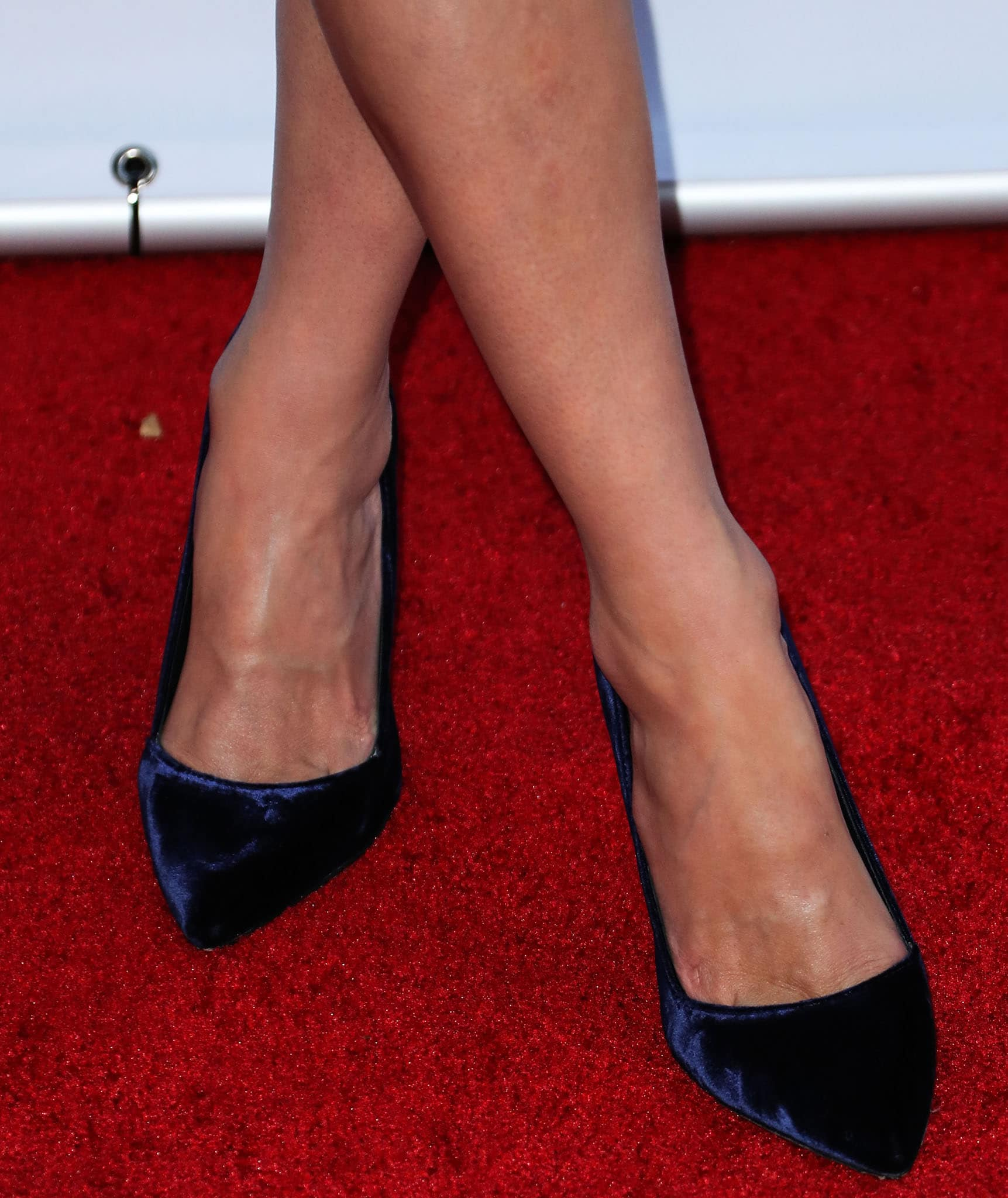 Nicky Hilton shows off her feet in navy velvet pointy pumps