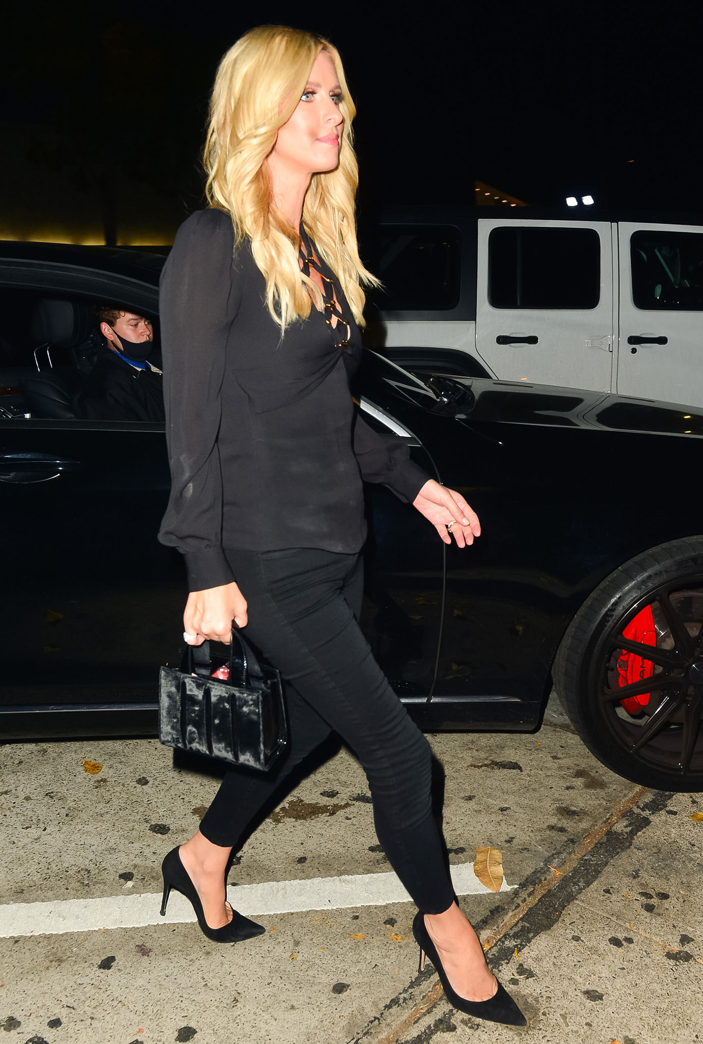 Nicky Hilton in a black lace-up blouse goes to Craig's for solo dinner
