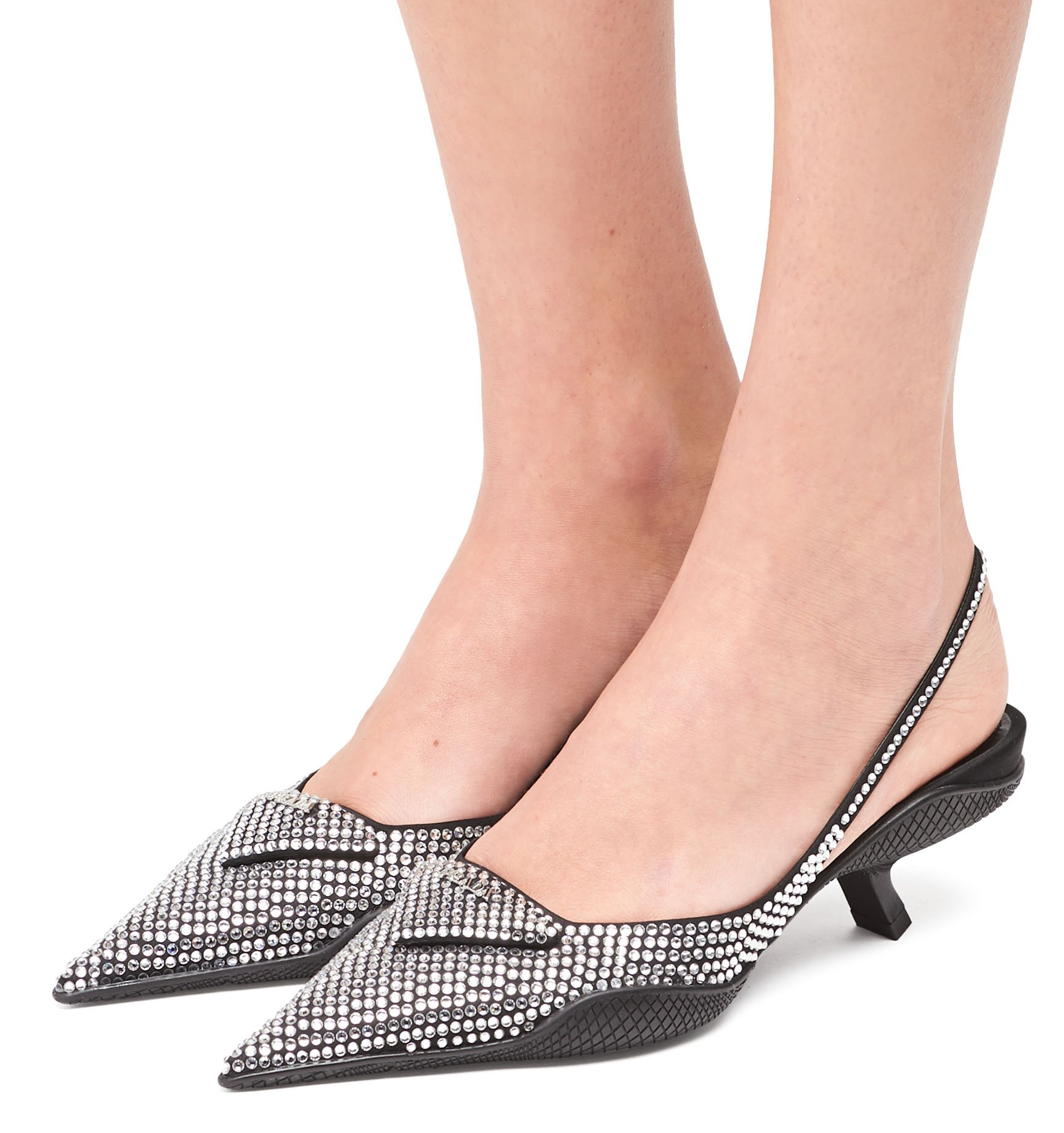These Prada slingback pumps are covered with sparkling crystals and have short comma heels