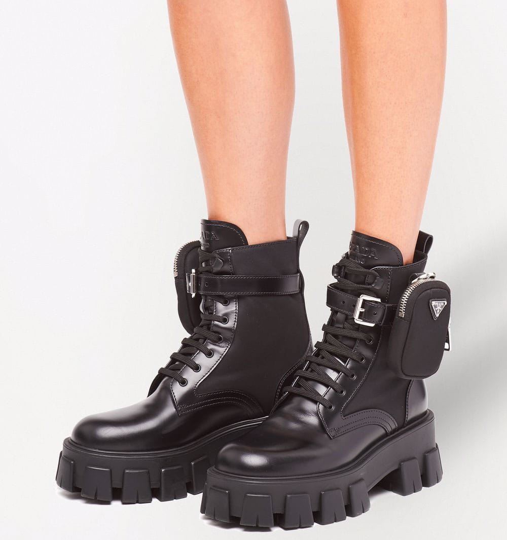 The Monolith combat boots by Prada have a belted zipped pouch and chunky lug soles