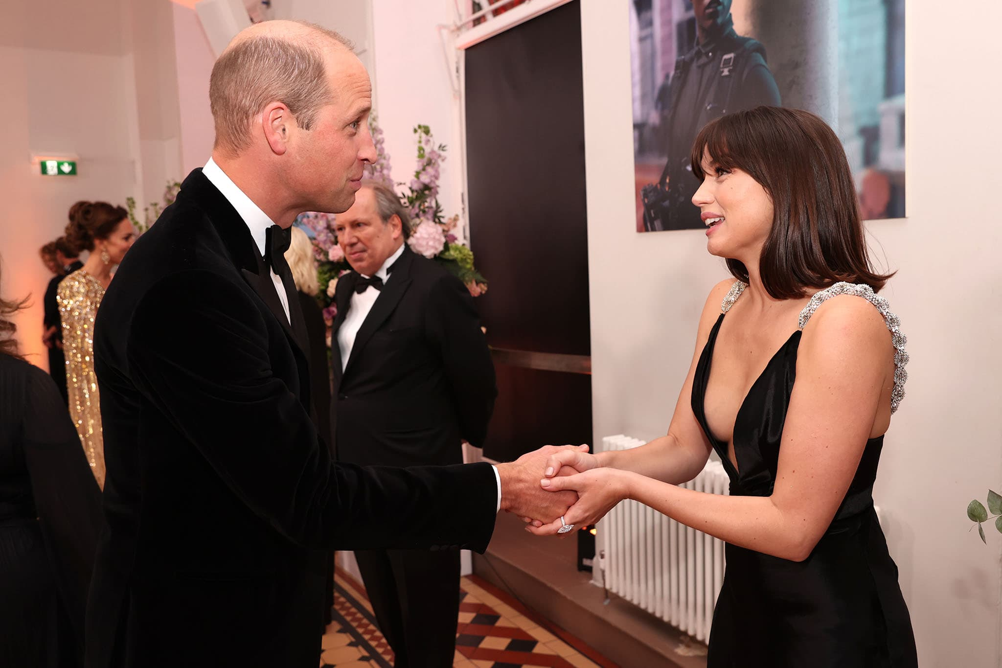 Prince William, Duke of Cambridge and Ana de Armas shake hands at the premiere of No Time to Die