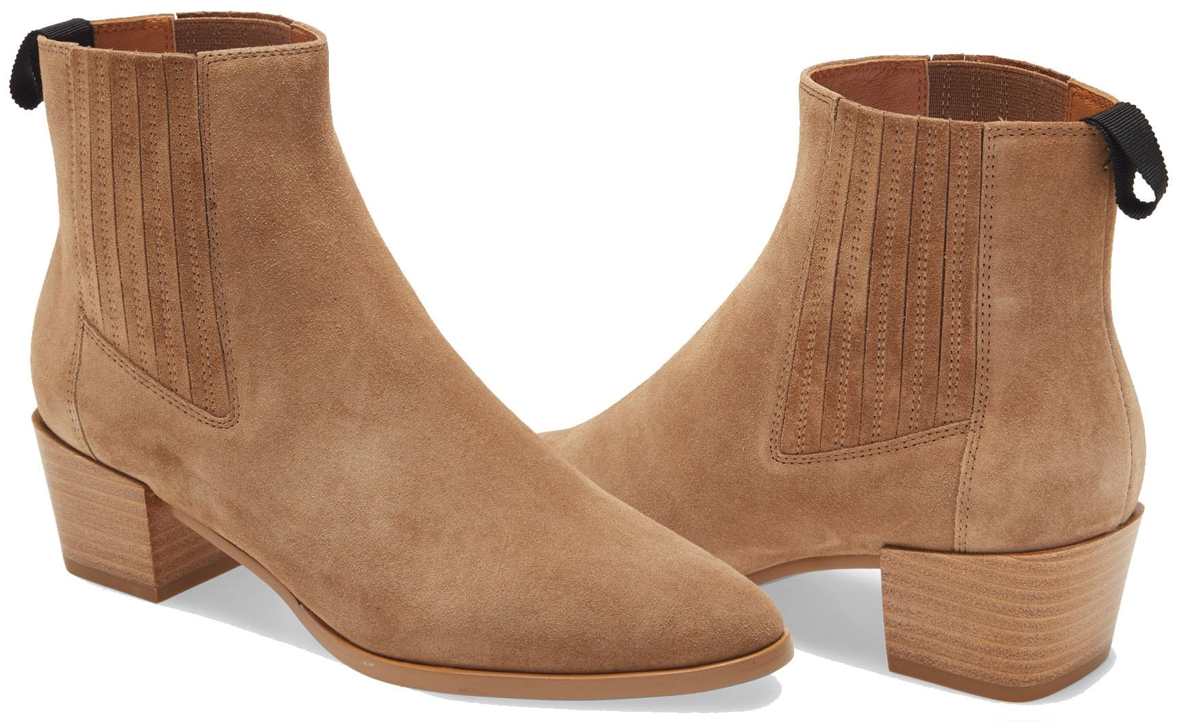 The Rover boots feature almond toes, covered elastic goring, and chunky stacked heels