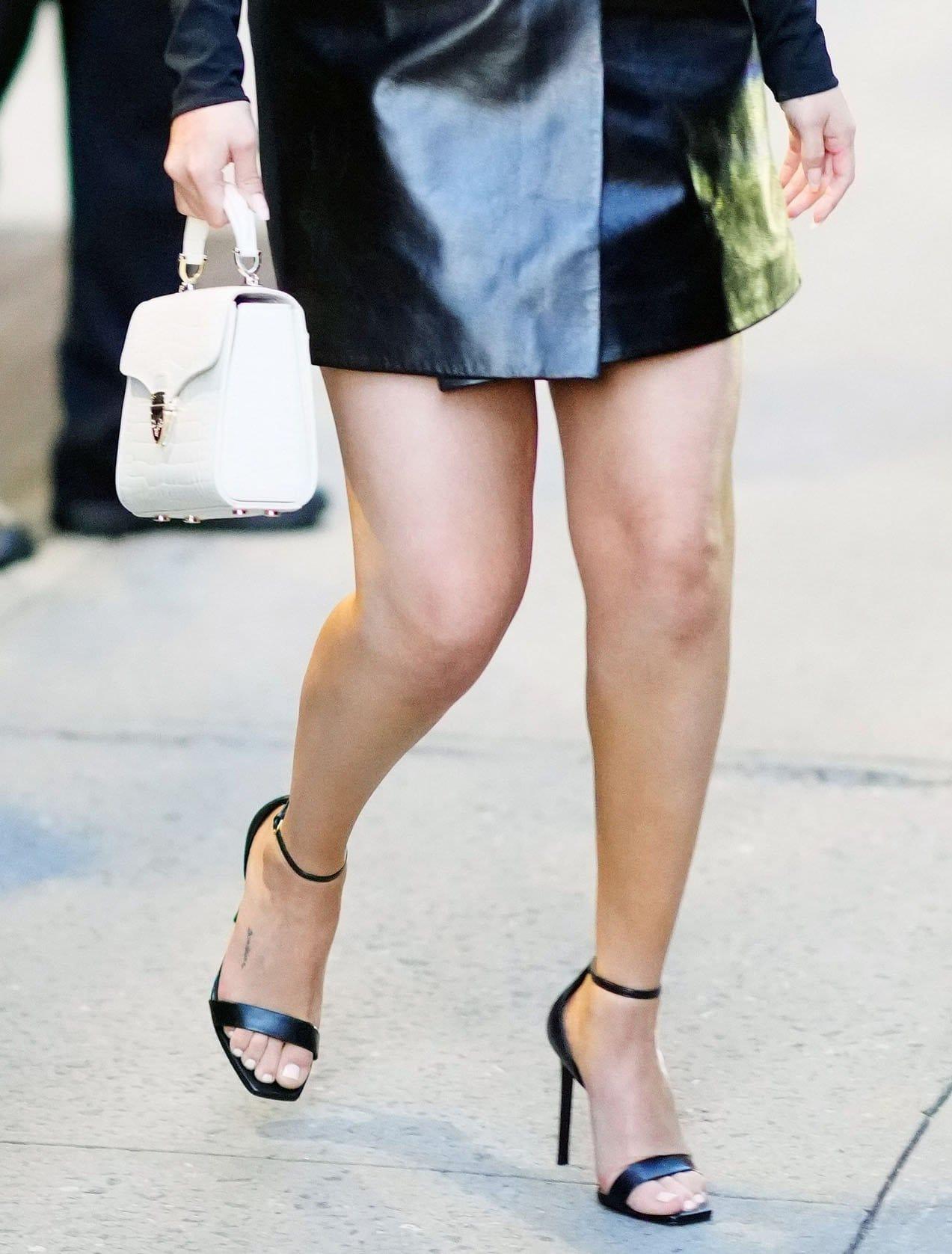"Selena Gomez shows off her ""sunshine"" foot tattoo in Saint Laurent Amber heels"