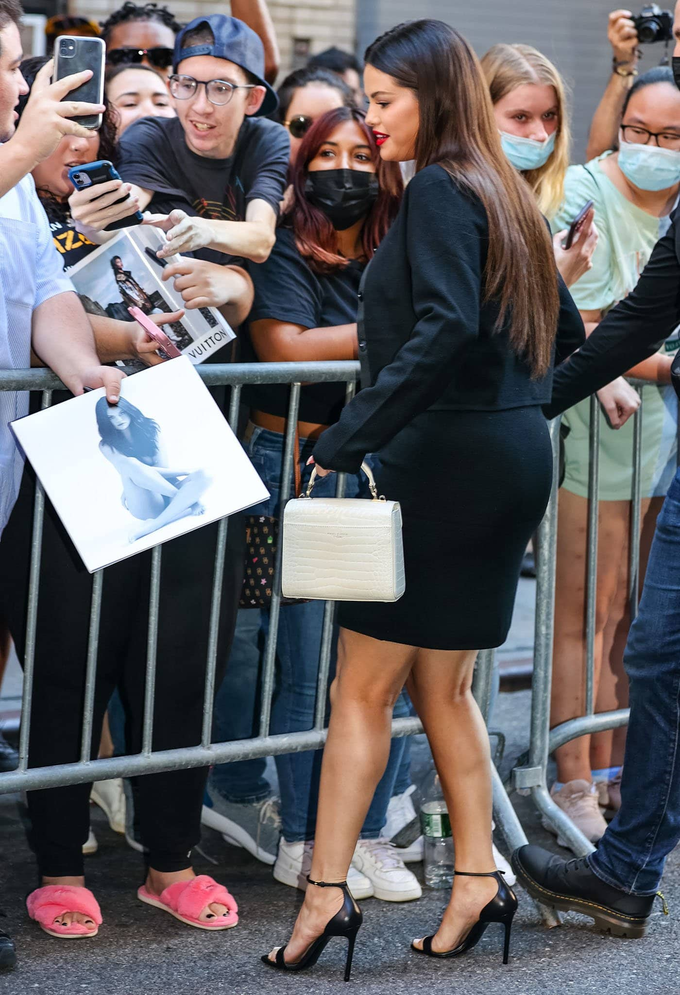 Selena Gomez is seen greeting her fans and signing autographs outside the Ed Sullivan Theater