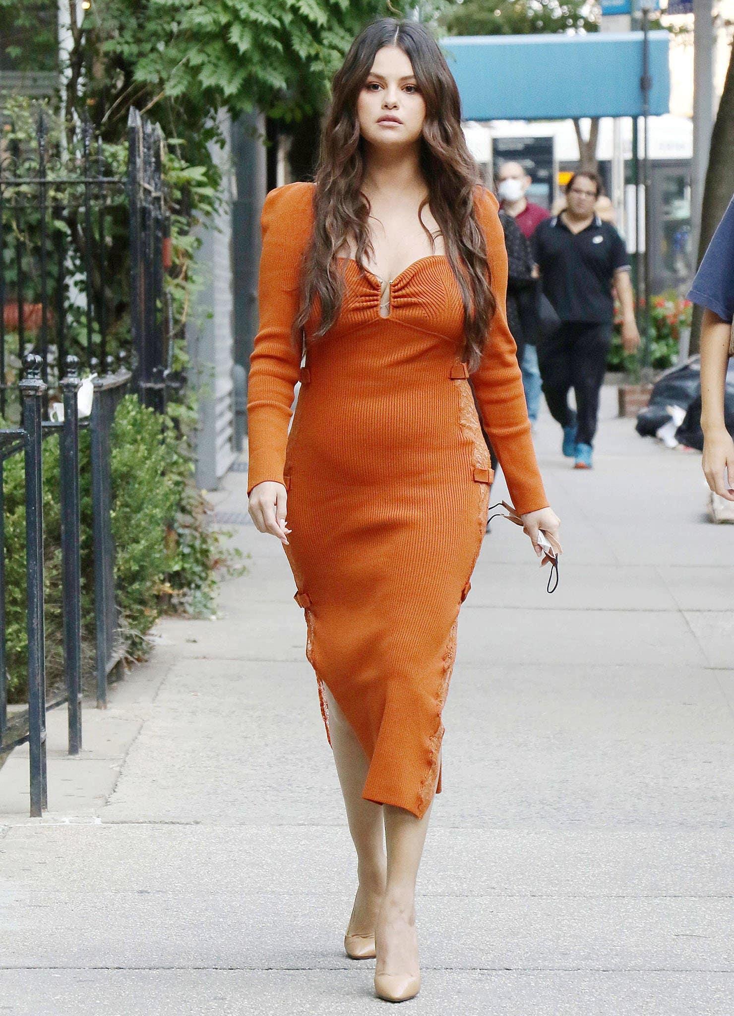 Selena Gomez flaunts curves in an orange Self-Portrait rib-knit midi dress