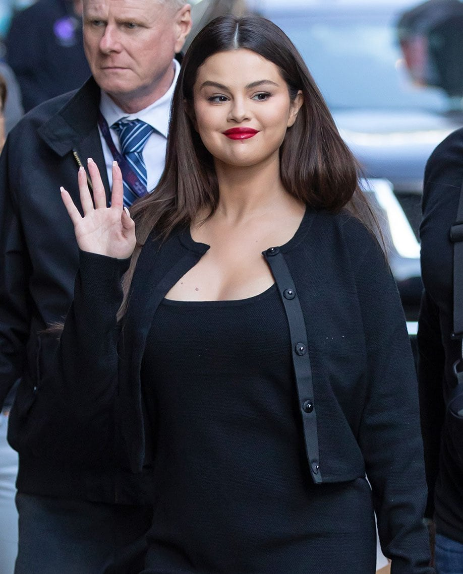 Selena Gomez adds a pop of bright red lip color to her head-to-toe black look