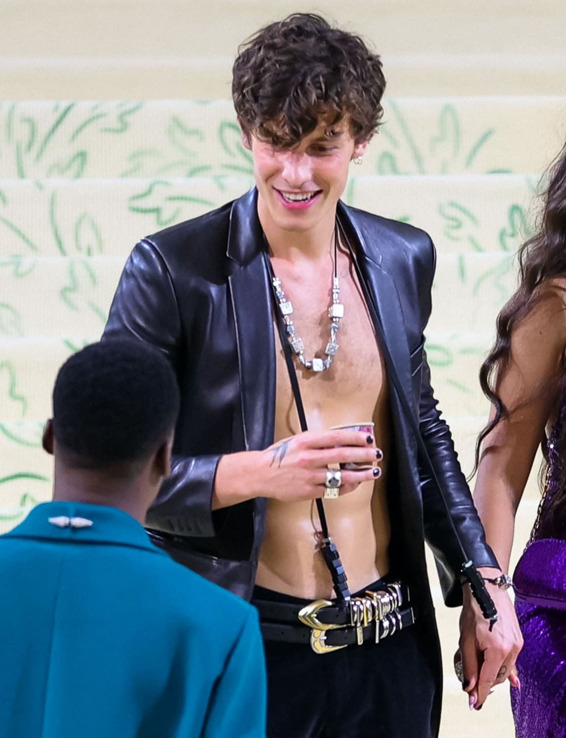 Shawn Mendes is shirtless underneath his Michael Kors jacket