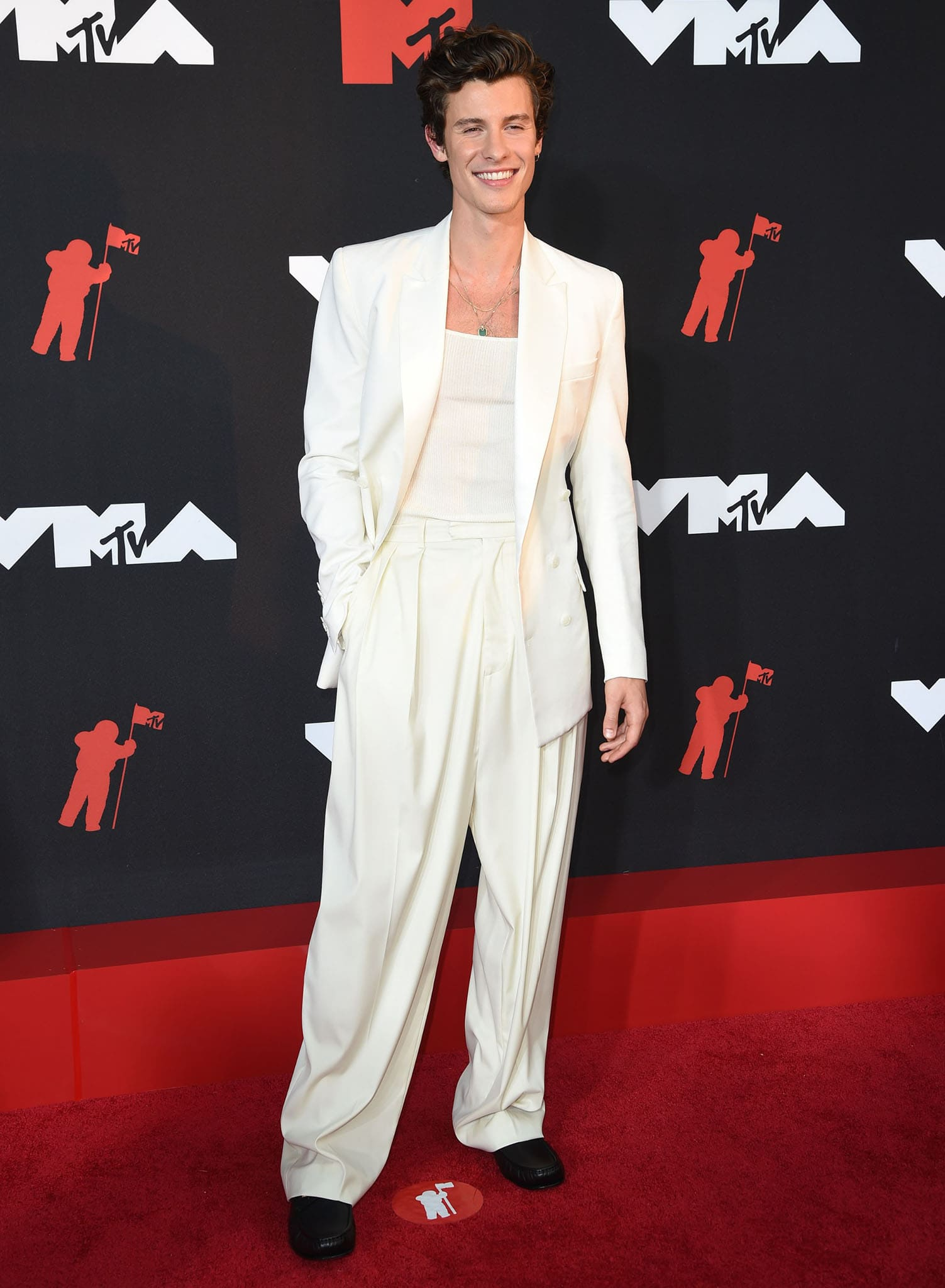 Shawn Mendes keeps it simple in a ribbed tank top with white blazer and cream pants