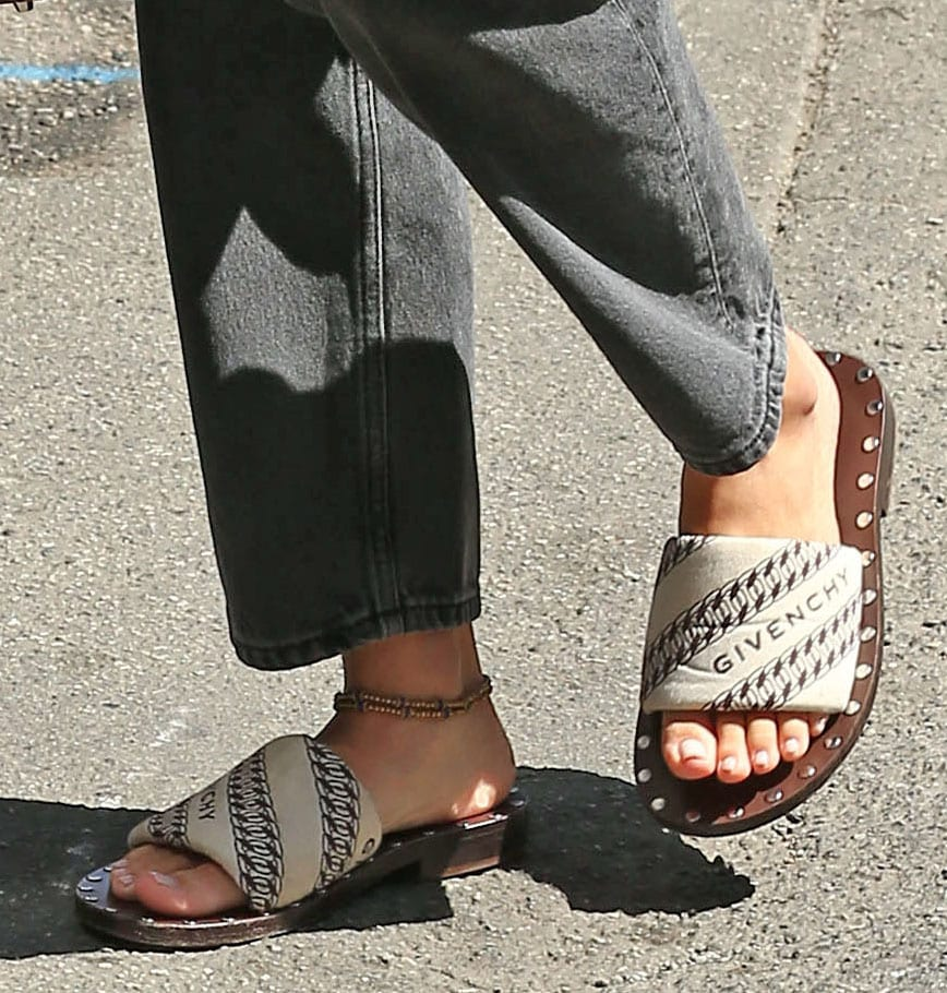 Sofia Richie completes her casual classic ensemble with Givenchy logo slide sandals