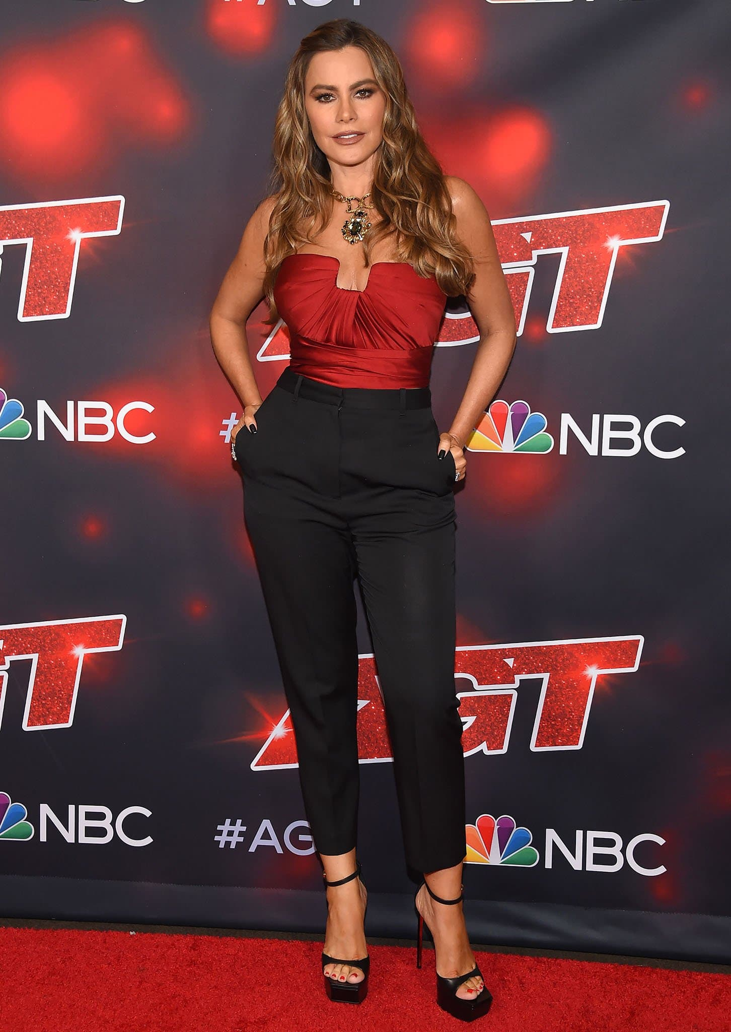 Sofia Vergara puts her hourglass figure on display in Alexander McQueen red bustier top and cigarette pants during the first night of the AGT Finale on September 14, 2021