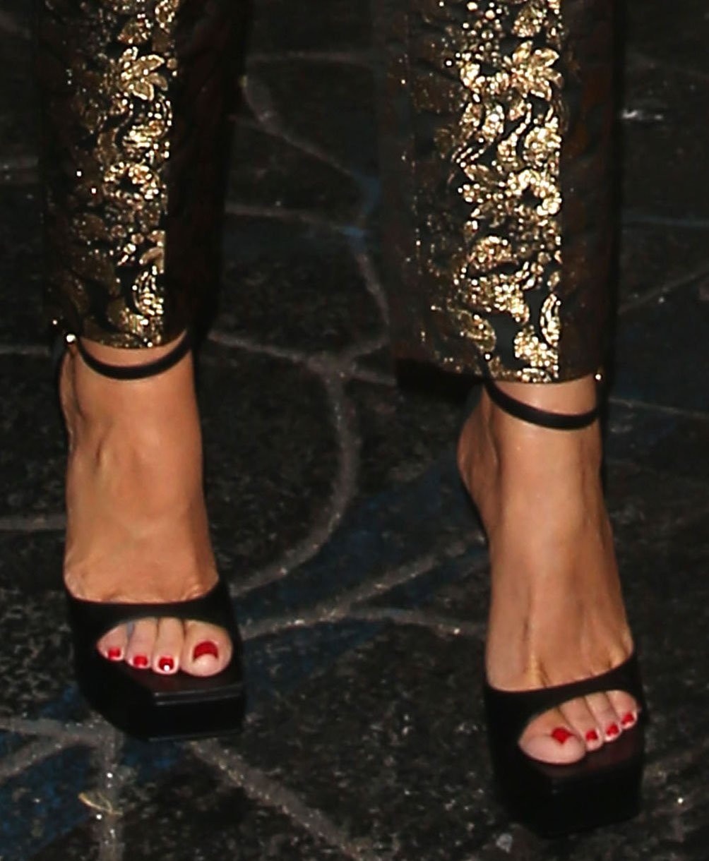 Sofia Vergara teams her sexy outfit with towering platform heels from Versace