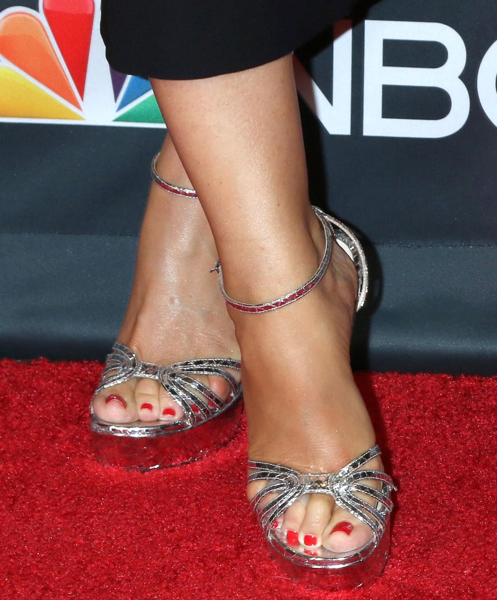 Sofia Vergara shows off her red pedicure in textured metallic leather platform sandals