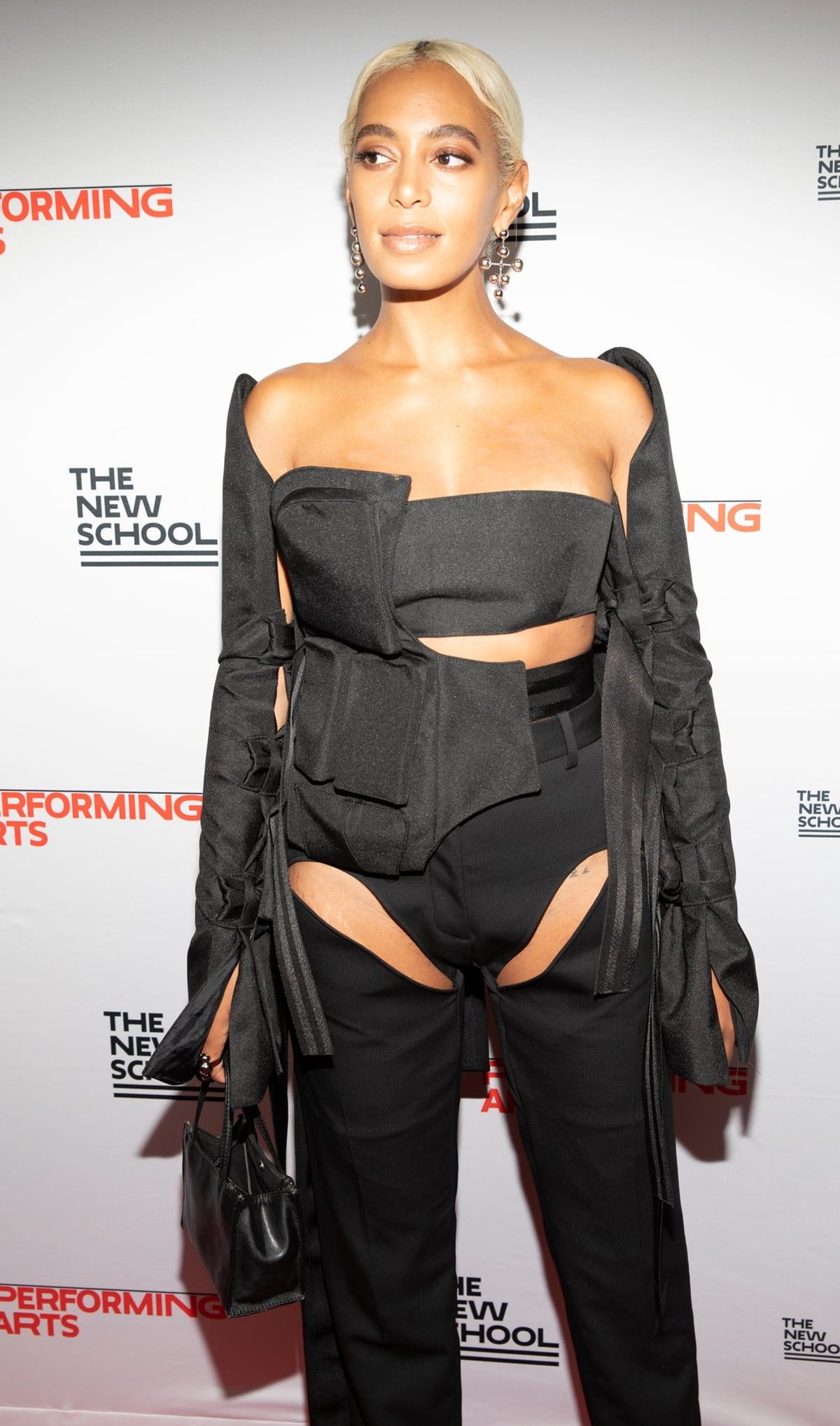 Solange Knowles carrying a small black Telfar shopping bag