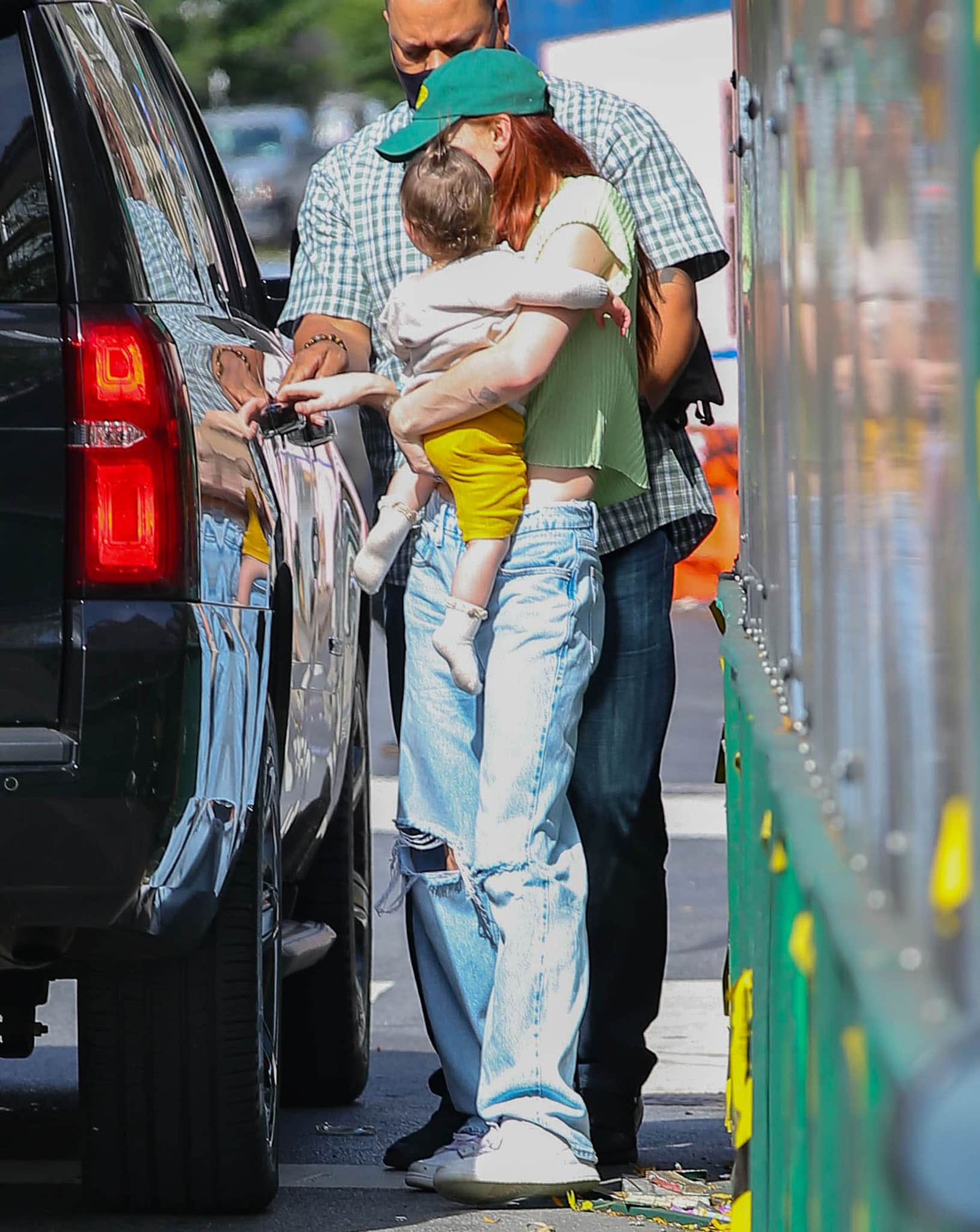 Sophie Turner carries her one-year-old daughter Willa in New York City