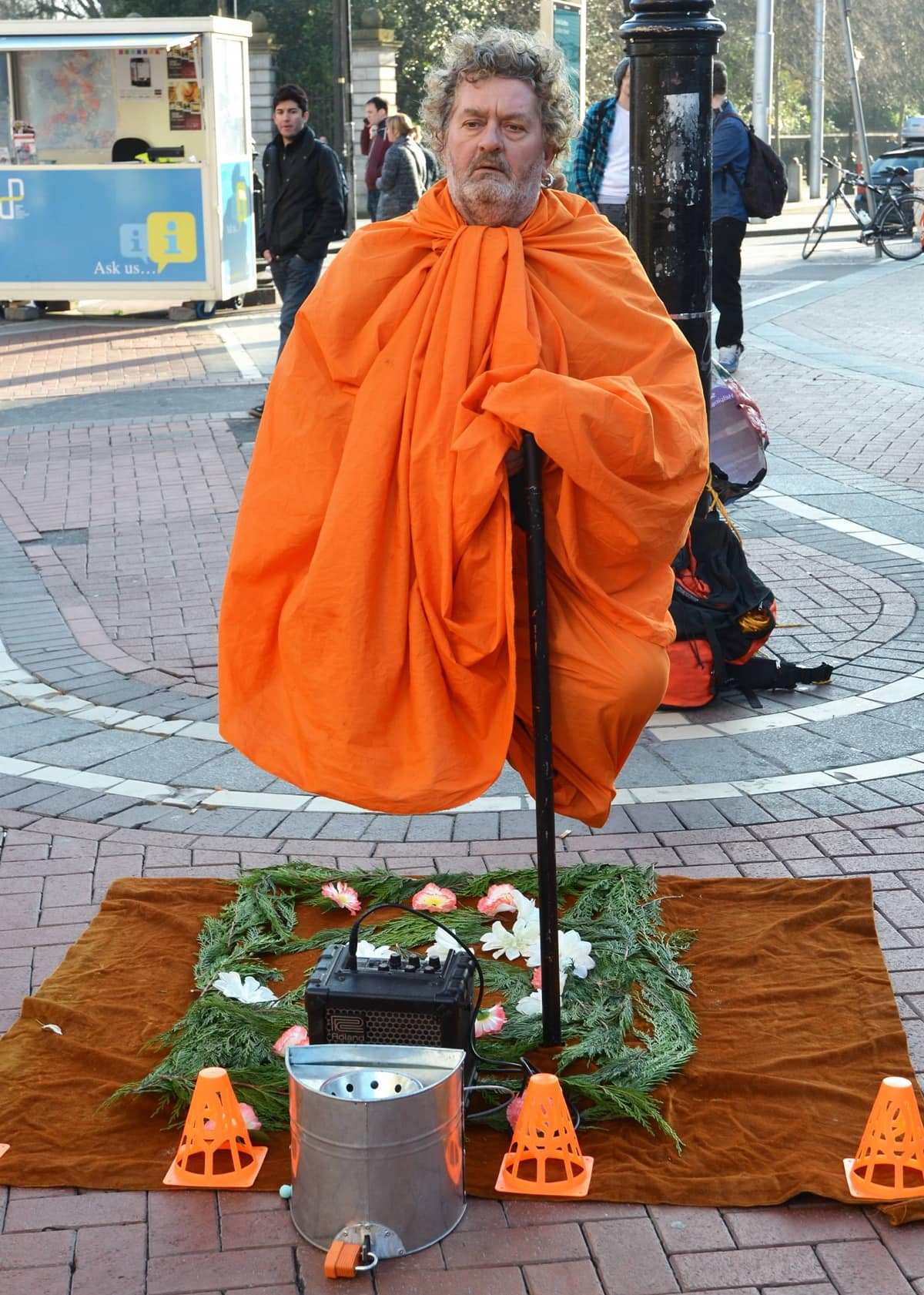 A street entertainer amazes shoppers on Galway's Shop Street in Dublin, Ireland, with his apparent ability to levitate
