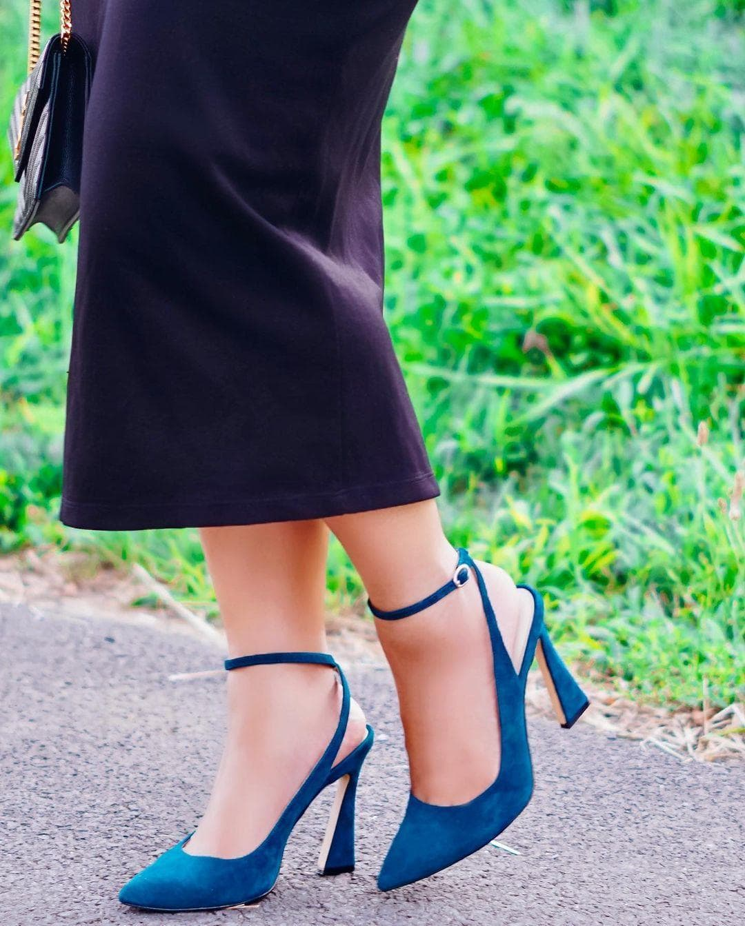 An elegant ankle strap and flared heel define this lofty teal suede pointy-toe dress pump from Nine West