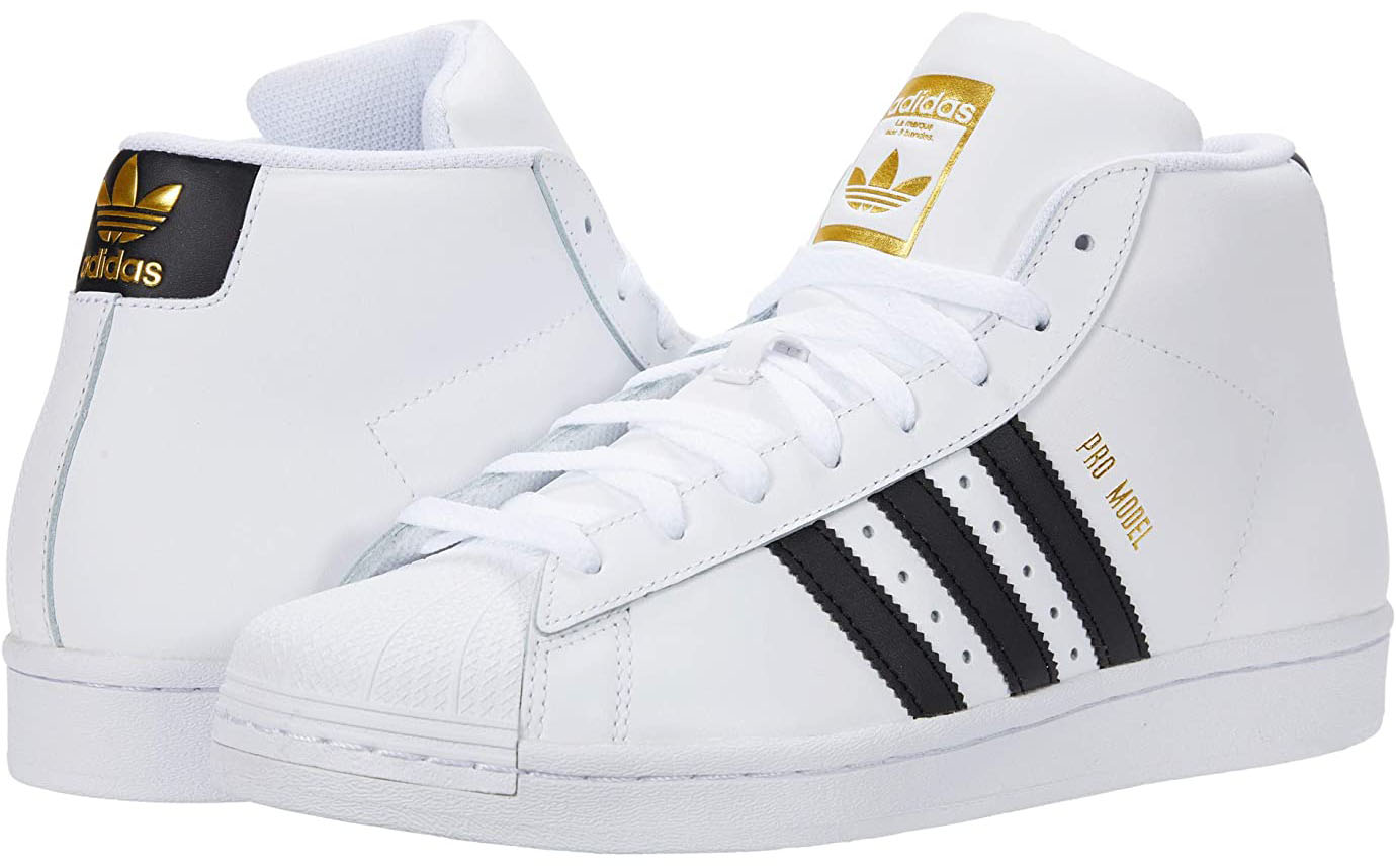 The Adidas Pro Model mid sneaker features classic logo branding on the rear and quarter panels