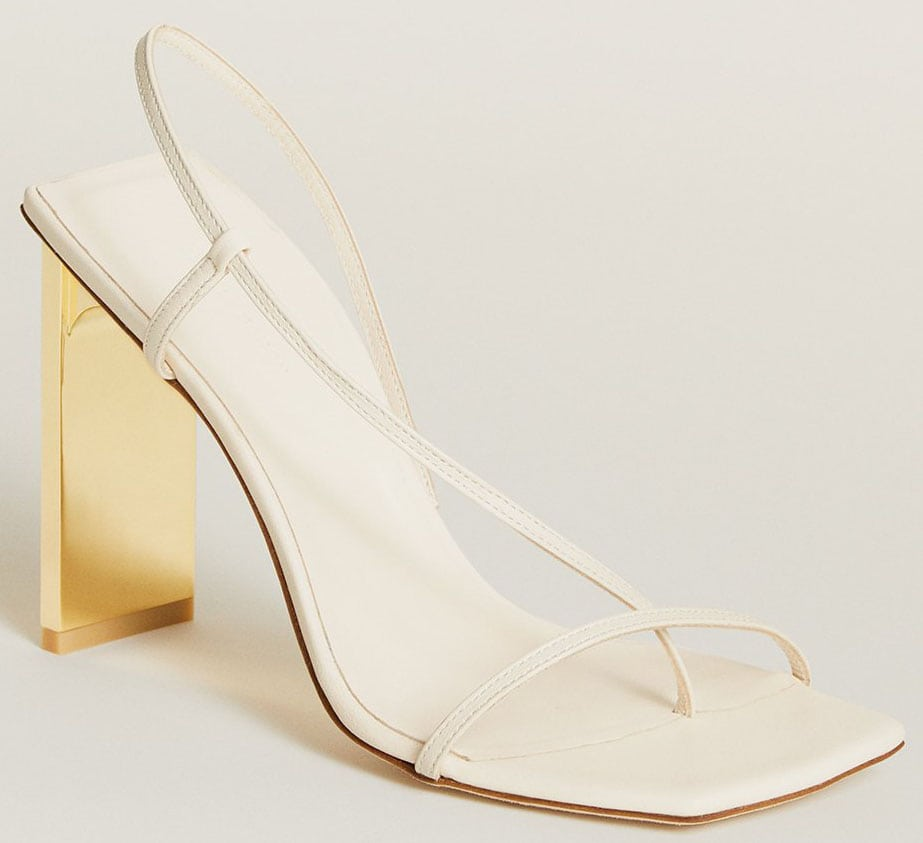 The Arielle Baron Narcissus sandals have trendy square toes, delicate asymmetric slingback straps, and gold mirror heels