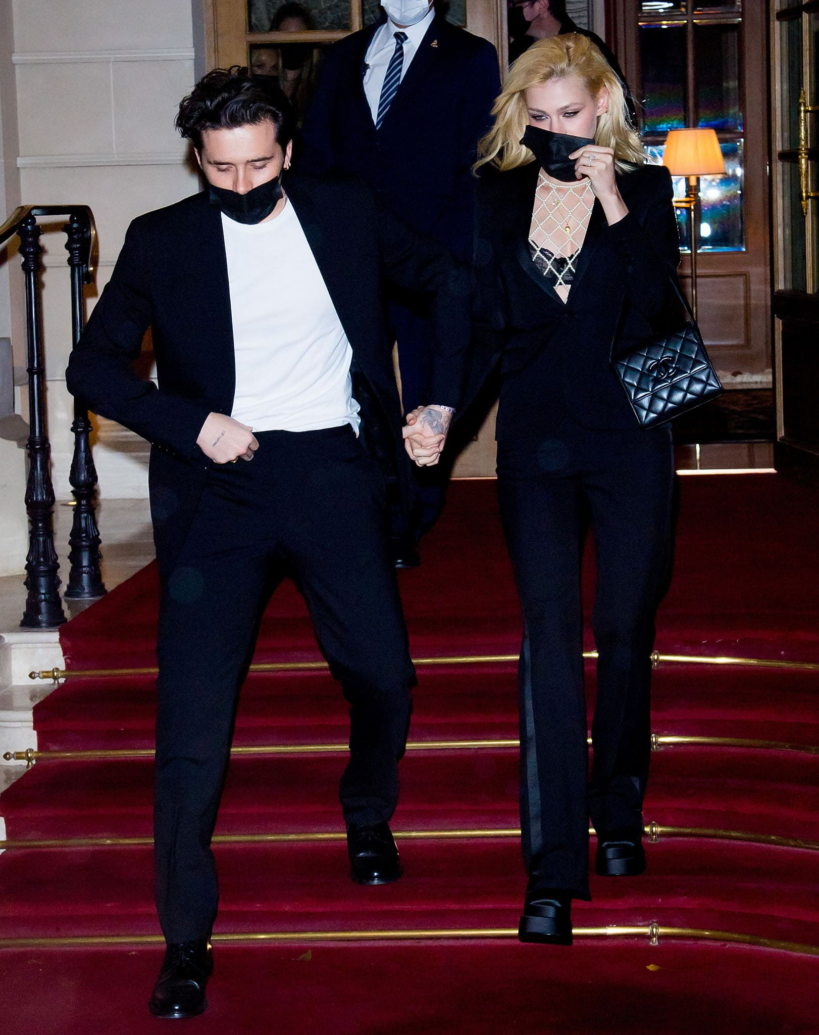 Brooklyn Beckham and Nicola Peltz leaving Ritz hotel in Paris in matching black suits on October 2, 2021