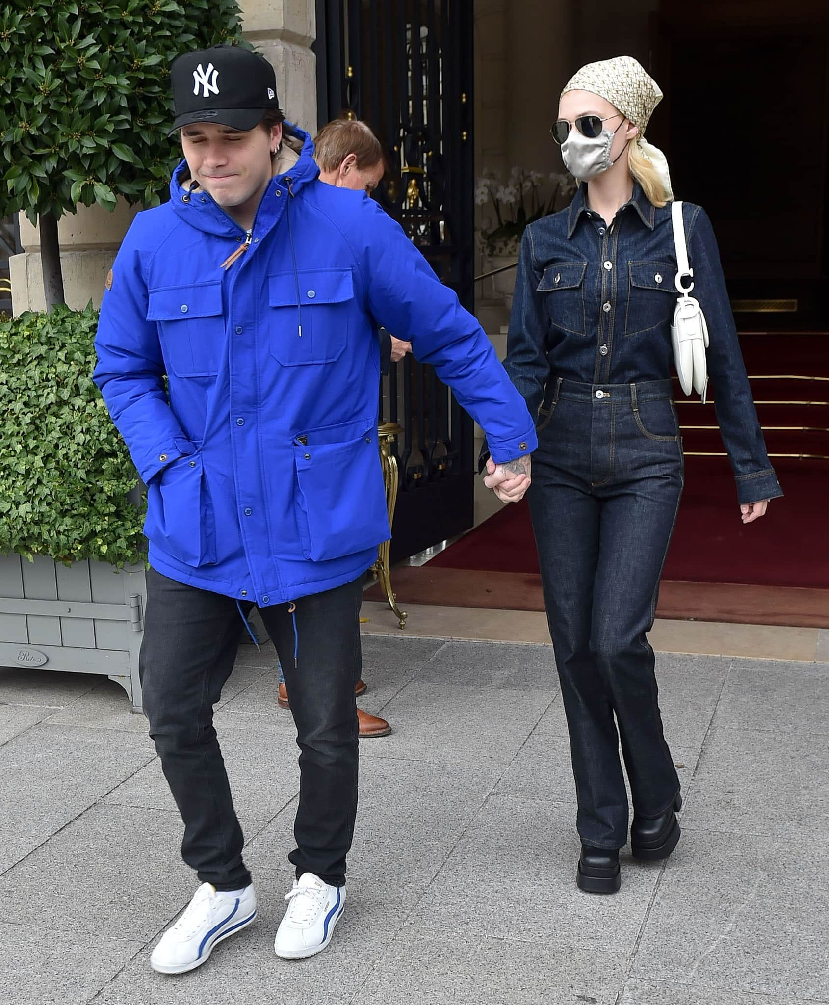Brooklyn Beckham bundles up in a blue jacket while Nicola Peltz embraces the double denim trend as they head to a flea market