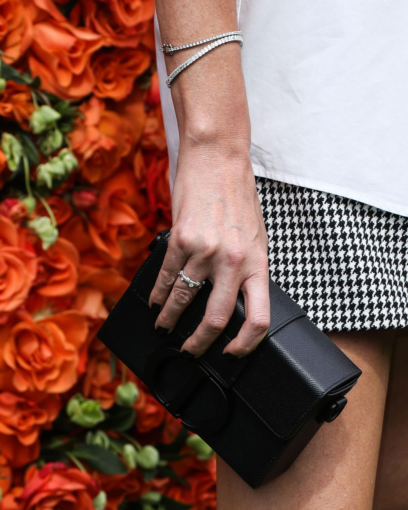 Charlize Theron carries her essentials in a Dior 30 Montaigne box bag