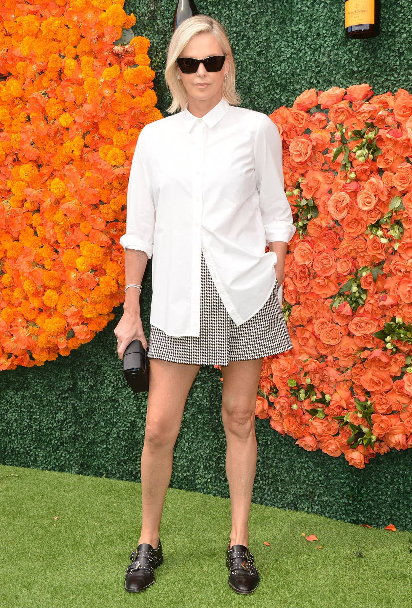 Charlize Theron in Givenchy monk strap shoes at the Veuve Clicquot Polo Classic Los Angeles