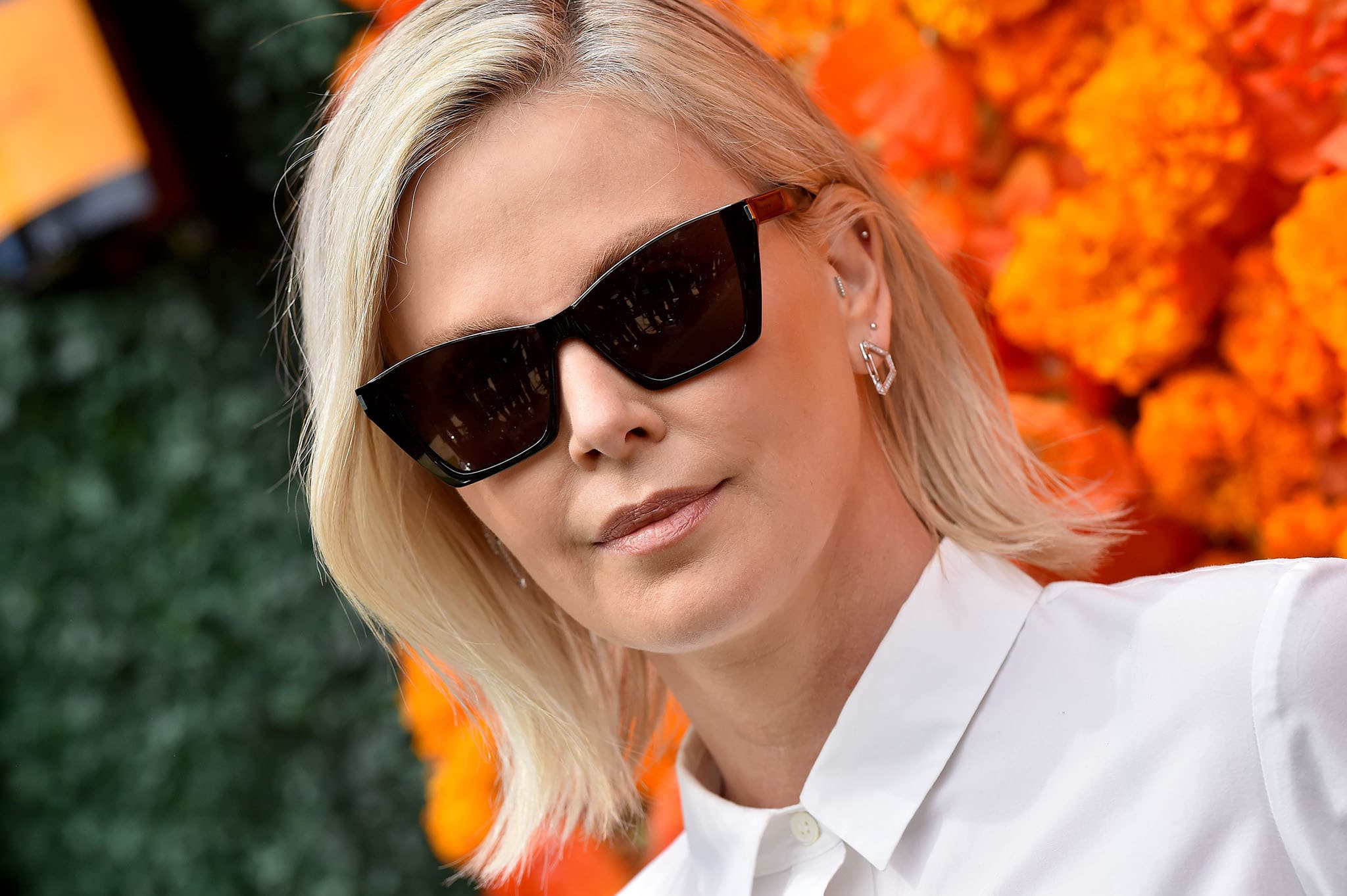 Charlize Theron opts for minimal makeup and wears her blonde hair down with a side parting