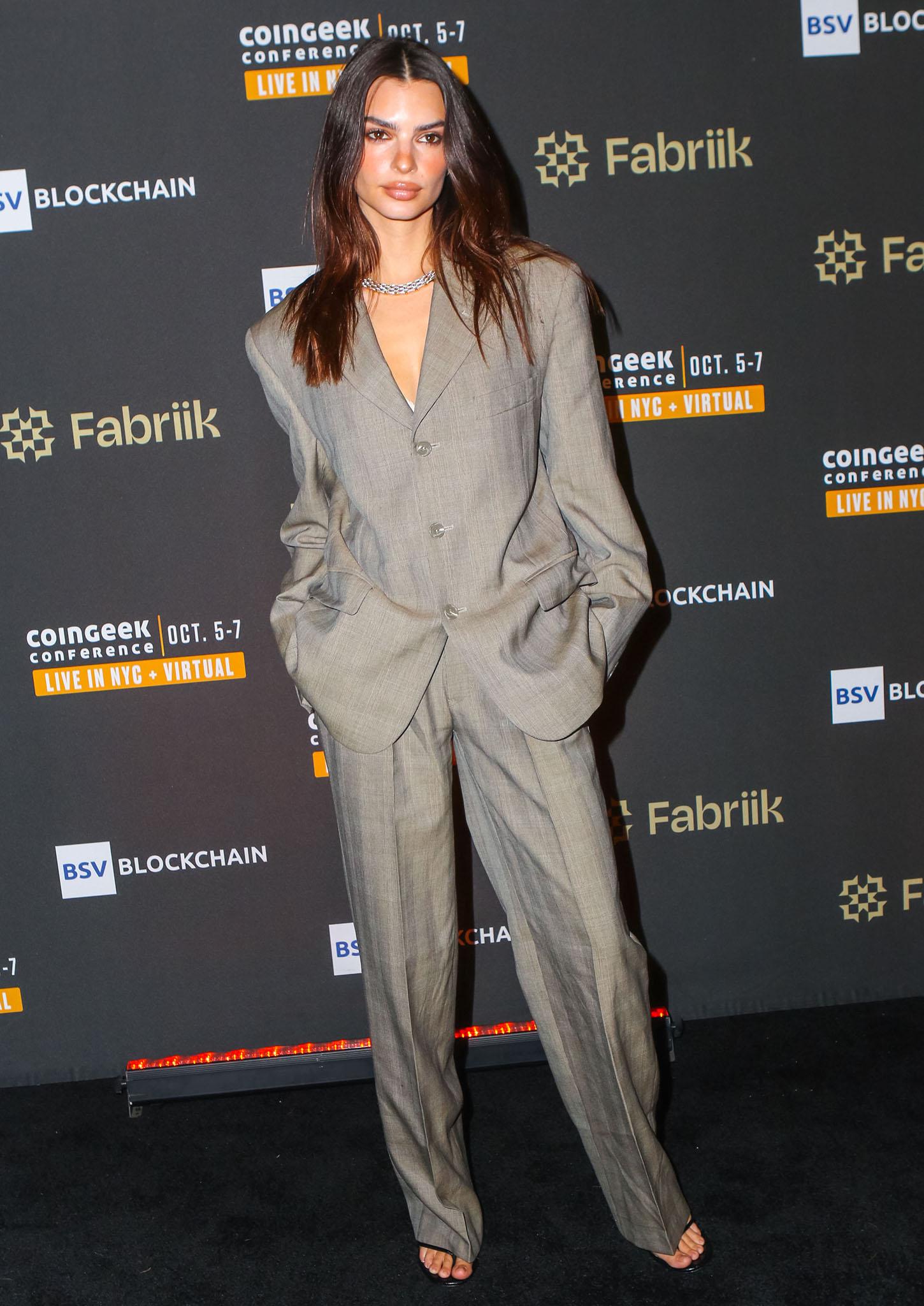 Emily Ratajkowski looks chic in a menswear-inspired Ralph Lauren Havre Studio gray suit