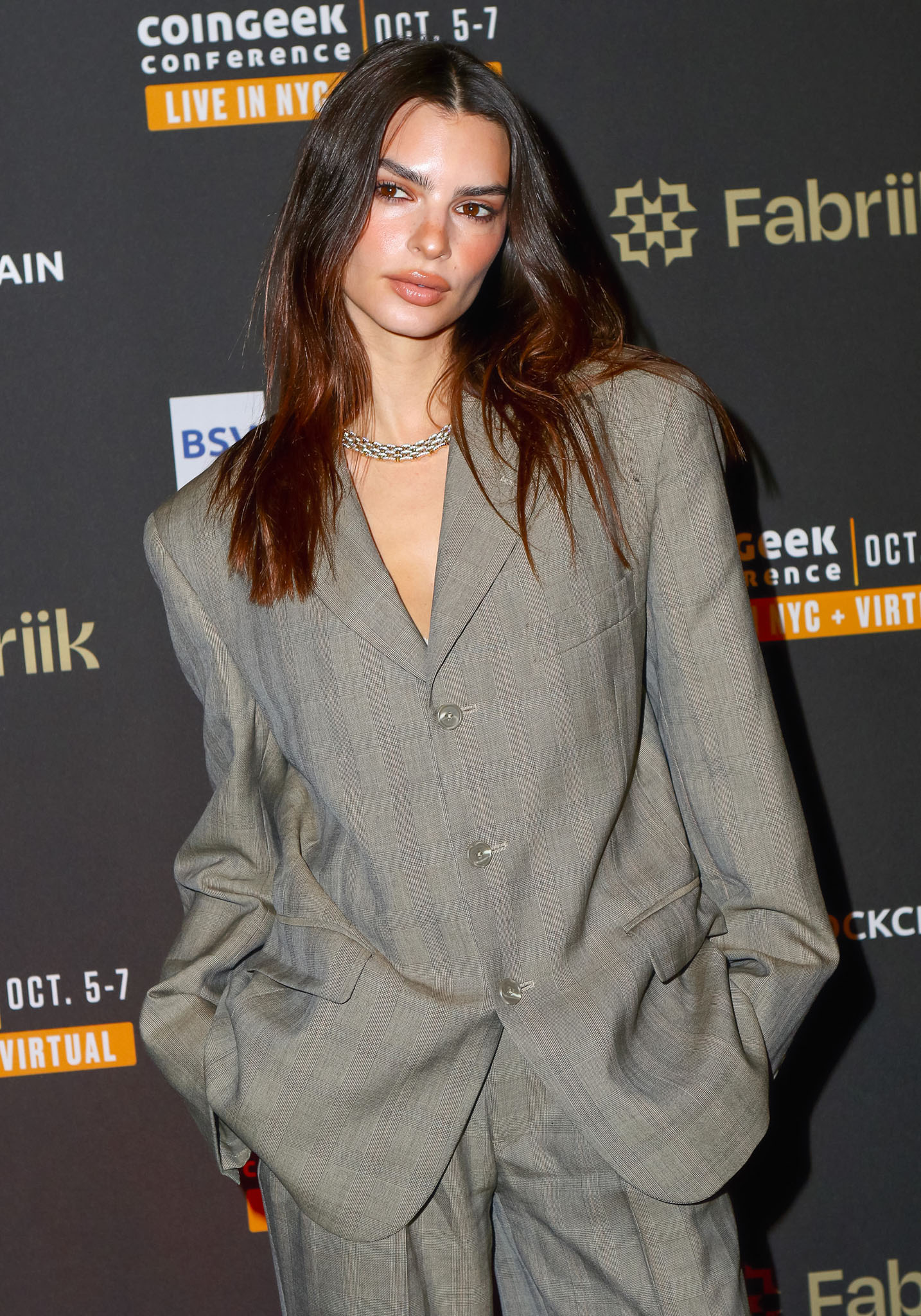 Emily Ratajkowski wears her signature sultry look with tousled hair and smokey eye-makeup