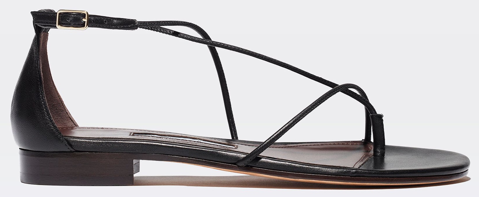 Emme Parsons' String sandal features nappa leather cords that curve asymmetrically around the instep