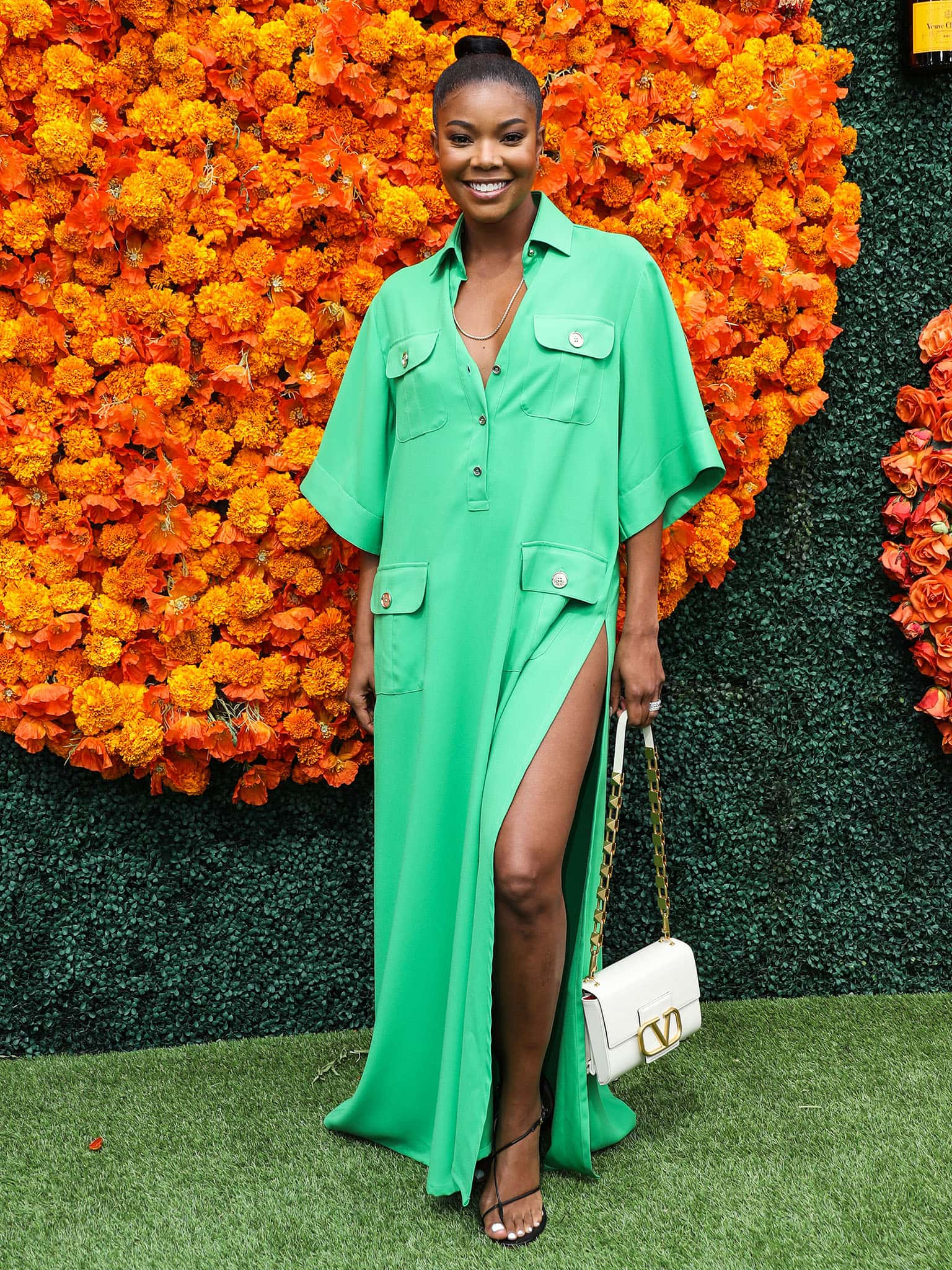 Gabrielle Union shows off her toned legs in an emerald green Elie Saab maxi shirtdress