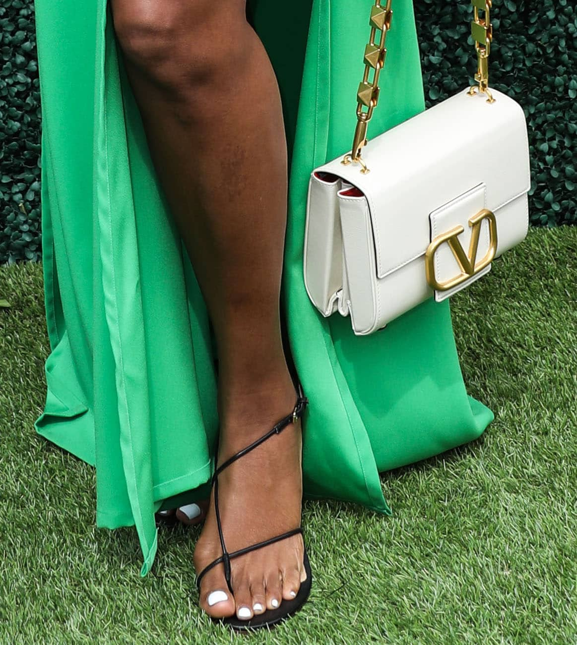 Gabrielle Union completes her afternoon look with a white Valentino bag and a pair of Emme Parsons flat sandals