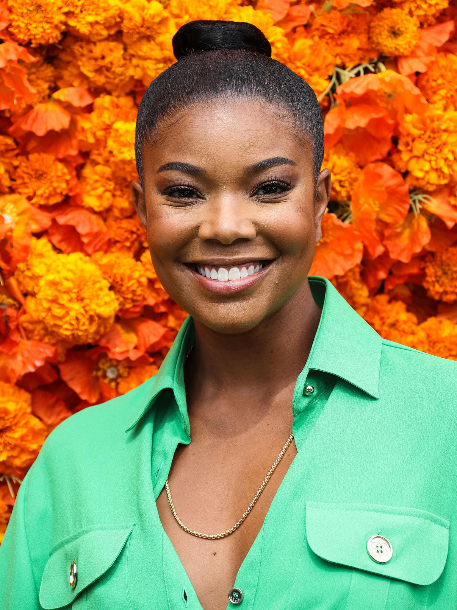 Gabrielle Union pulls her tresses back into a bubble ponytail and highlights her features with neutral makeup
