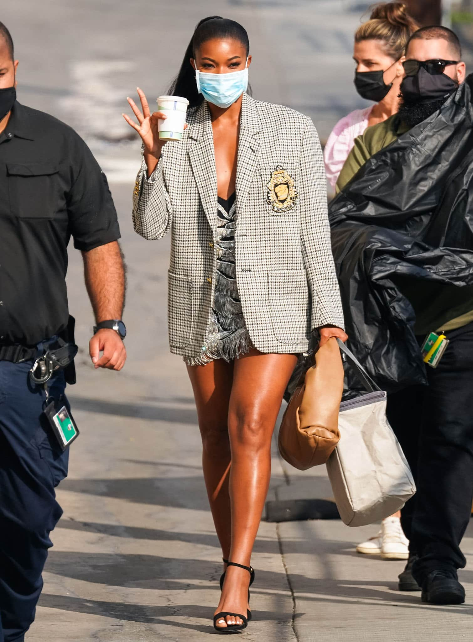 Gabrielle Union showcases her legs in a Dundas flapper-style fringe mini dress and a large blazer