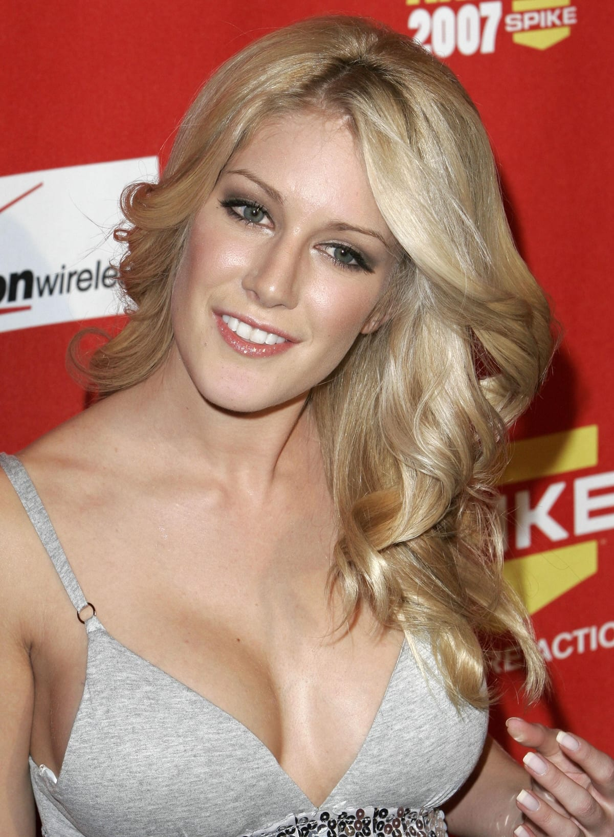 Heidi Montag highlights her boobs in a LaRok mirage sequined dress