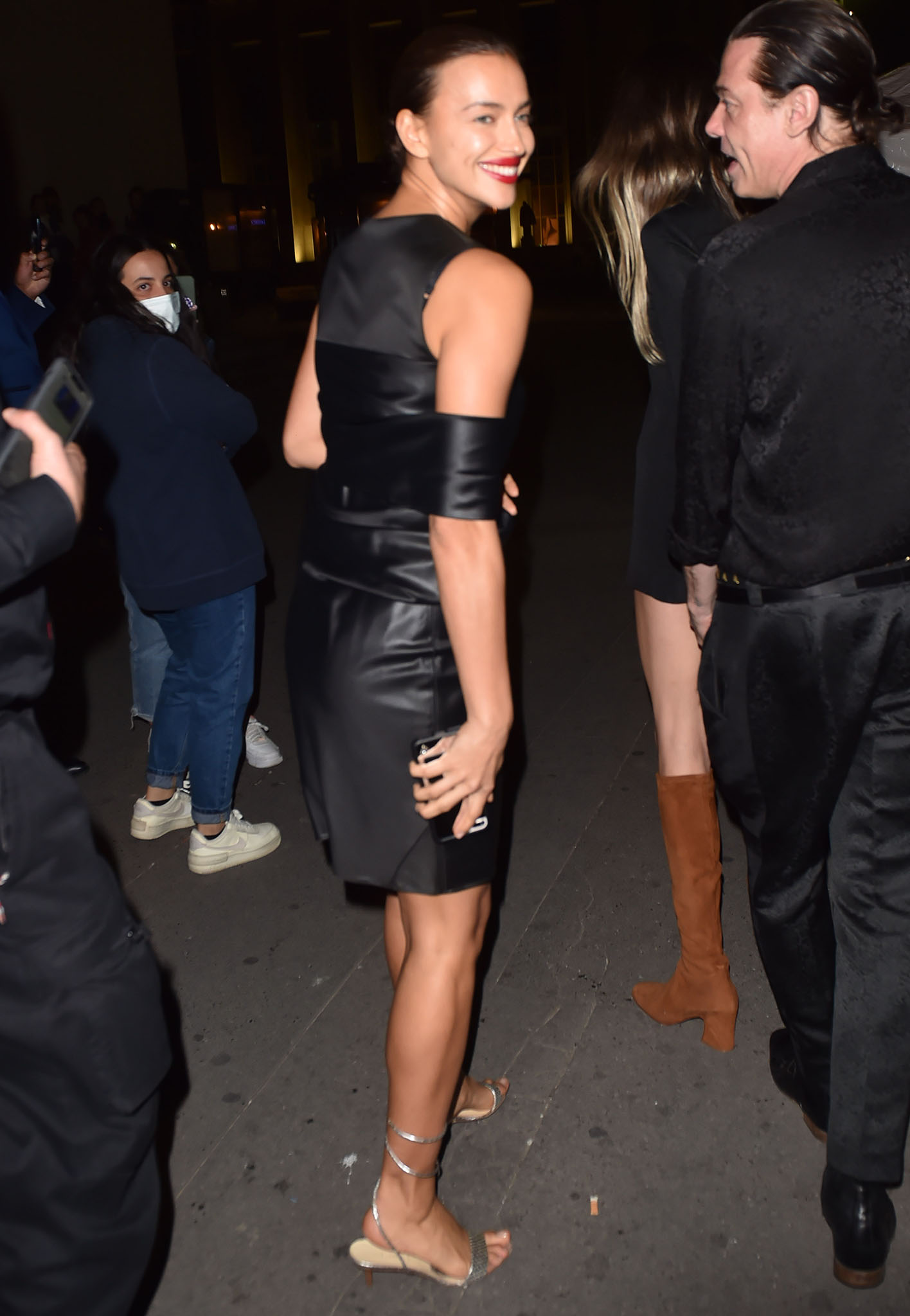 Irina Shayk wears an archival Helmut Lang leather dress with strappy silver sandals