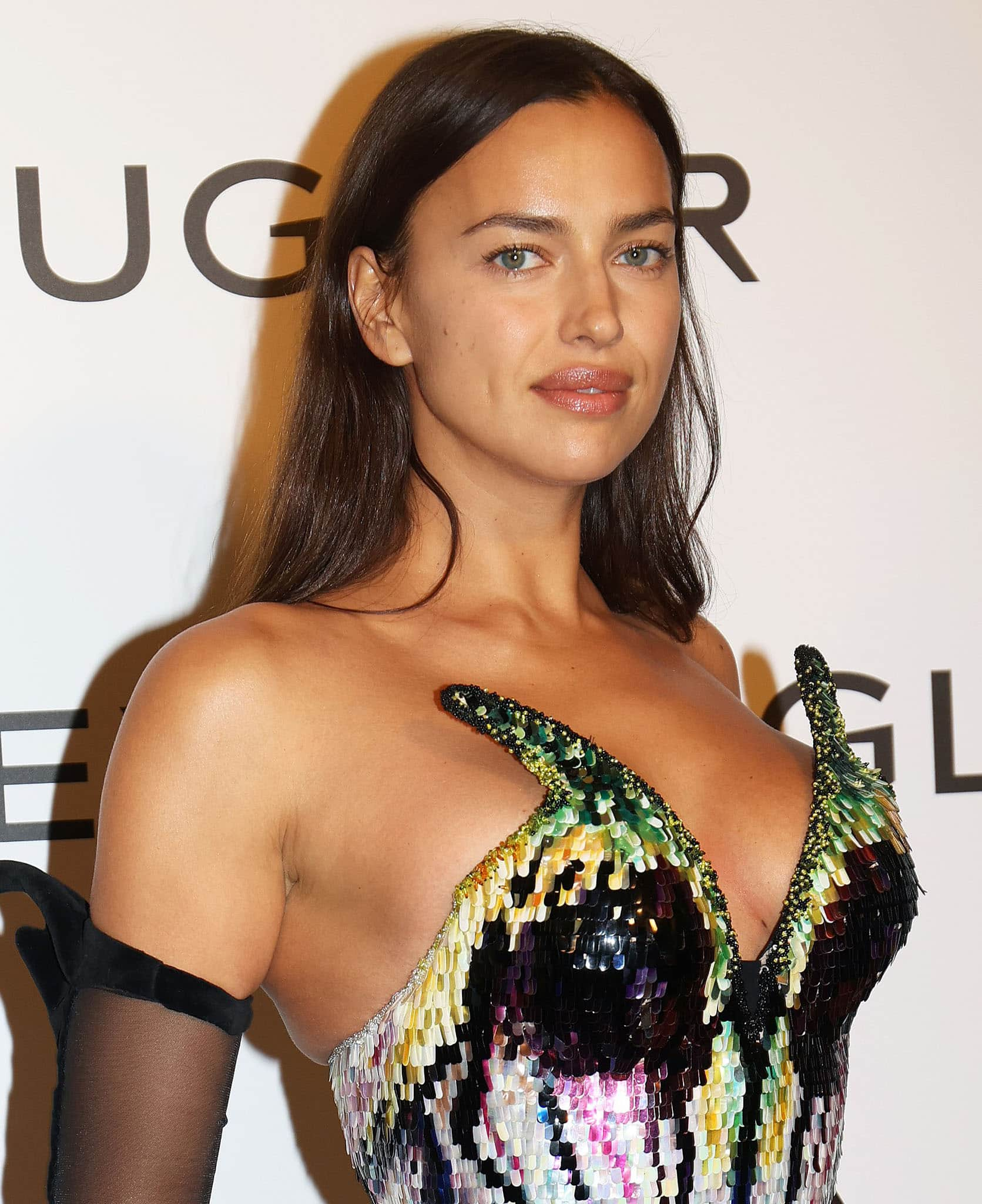 Irina Shayk simply wears her hair down with minimal makeup to allow her sequined dress to take center stage