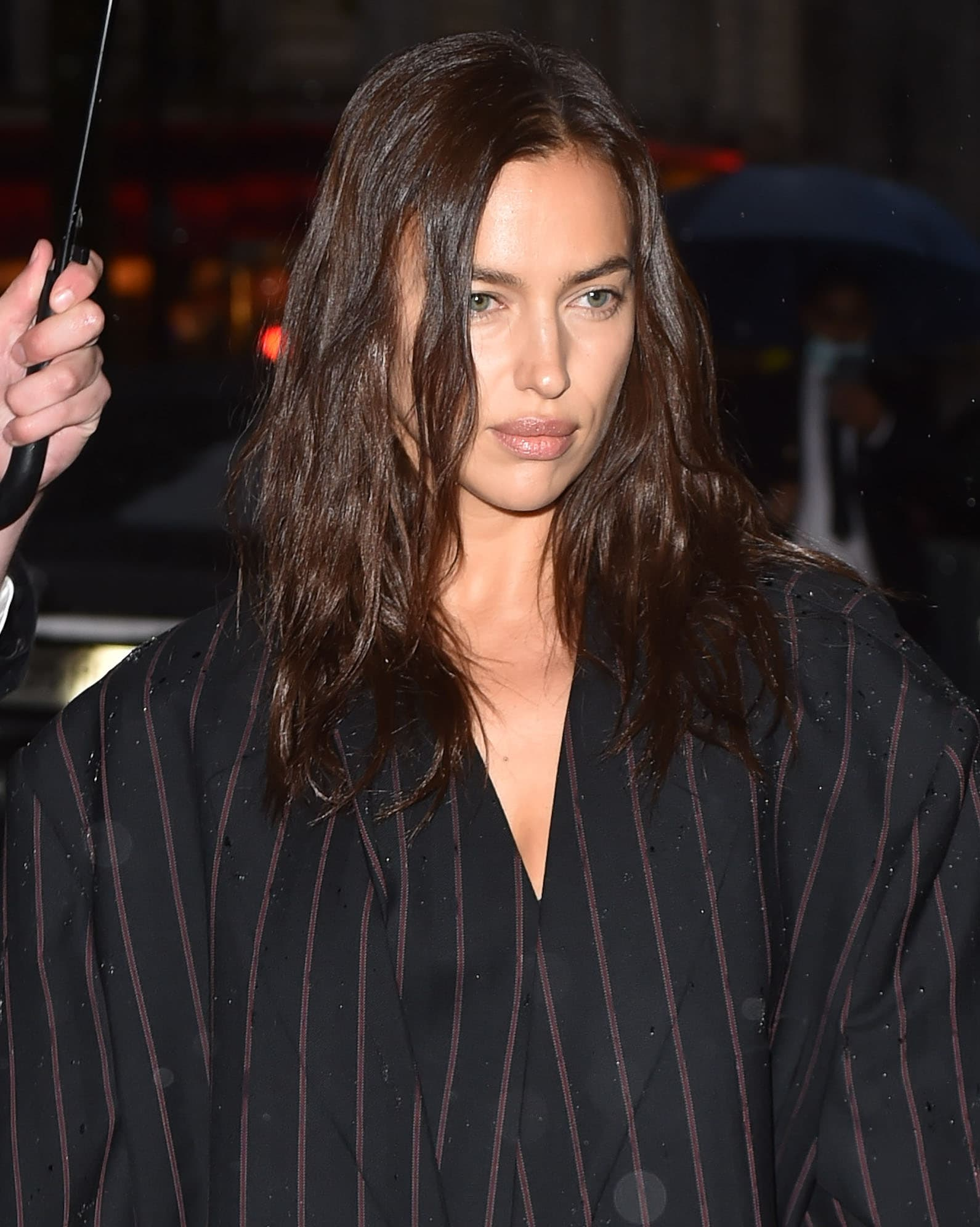 Irina Shayk wears barely-there makeup and lets her brunette tresses fall loose in tousled waves around her shoulders